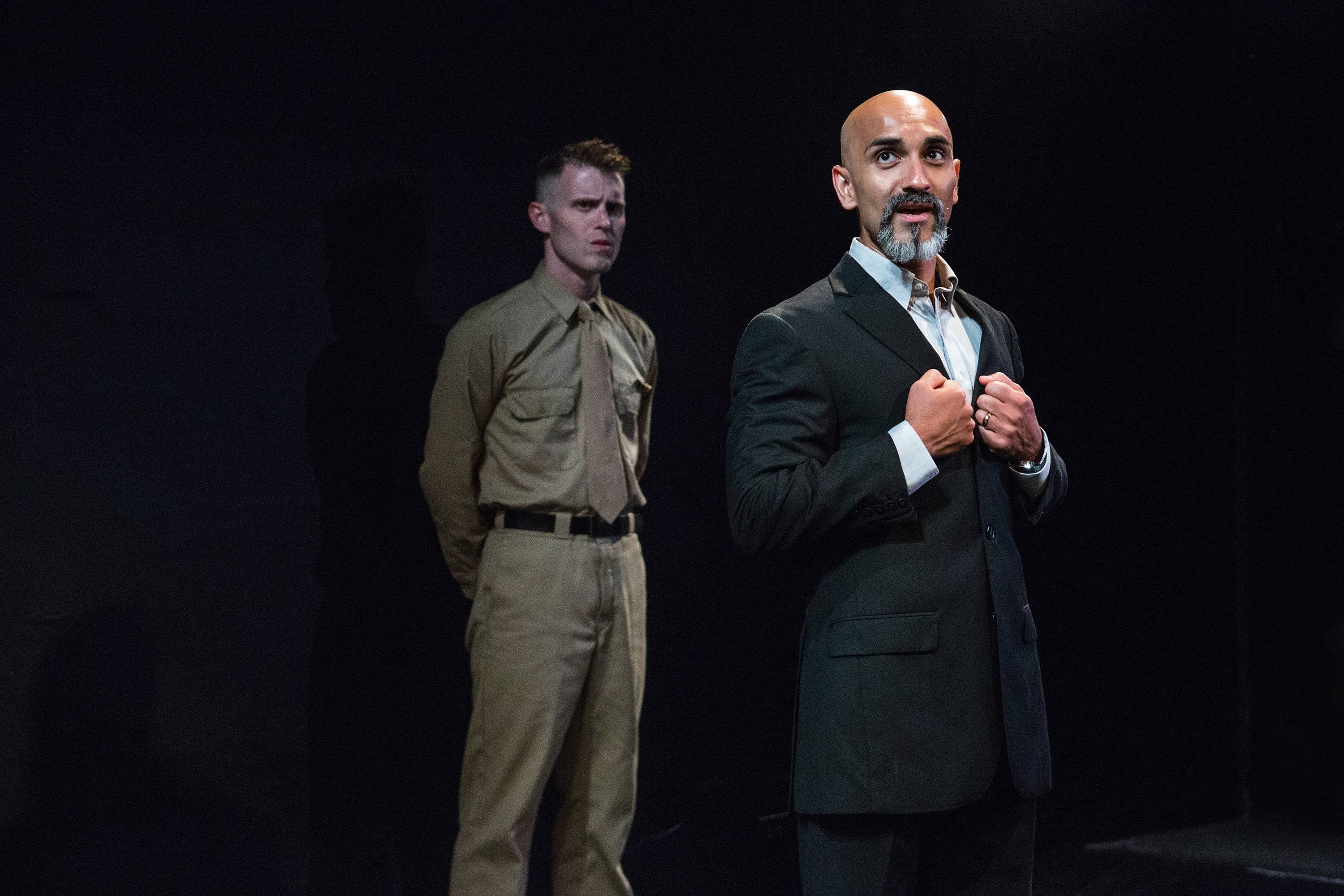 Acclaimed as a soldier, Othello (Kareem Bandealy, right) finds it much more difficult to be a husband in The Gift Theatre's production of Shakespeare's tragedy, which features Jay Worthington, left, as Lt. Cassio.