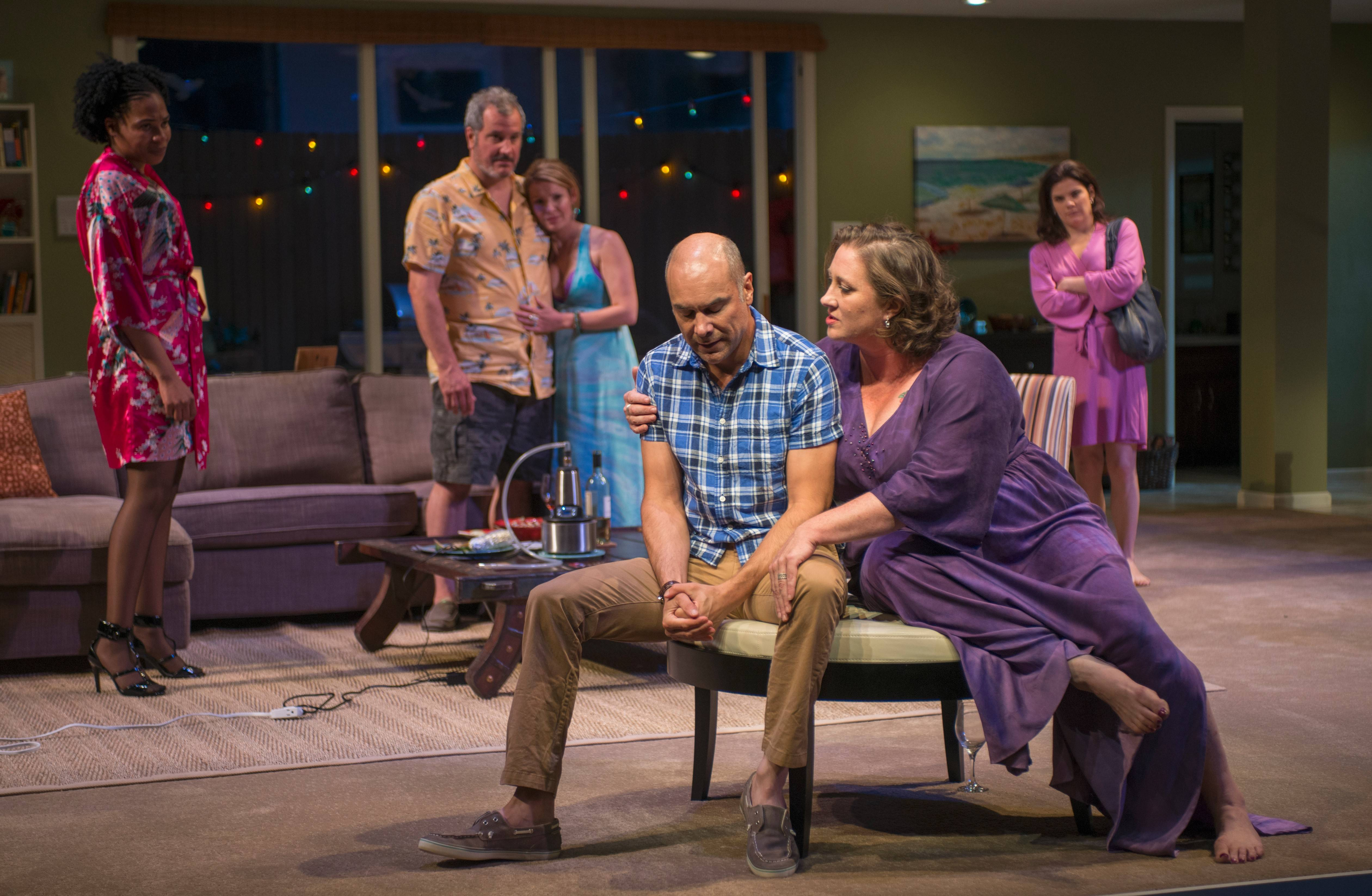 "Regine (Karen Aldridge, left), Gary (Keith Kupferer), Teri (Kate Arrington) and Kristy (Diane Davis, right) look on as Deb (Kirsten Fitzgerald, front) tries to convince Chris (Greg Stuhr) about a differing viewpoint on intimacy by making a sexual advance on him in the world premiere of Bruce Norris' ""The Qualms"" at Steppenwolf Theatre Company in Chicago."