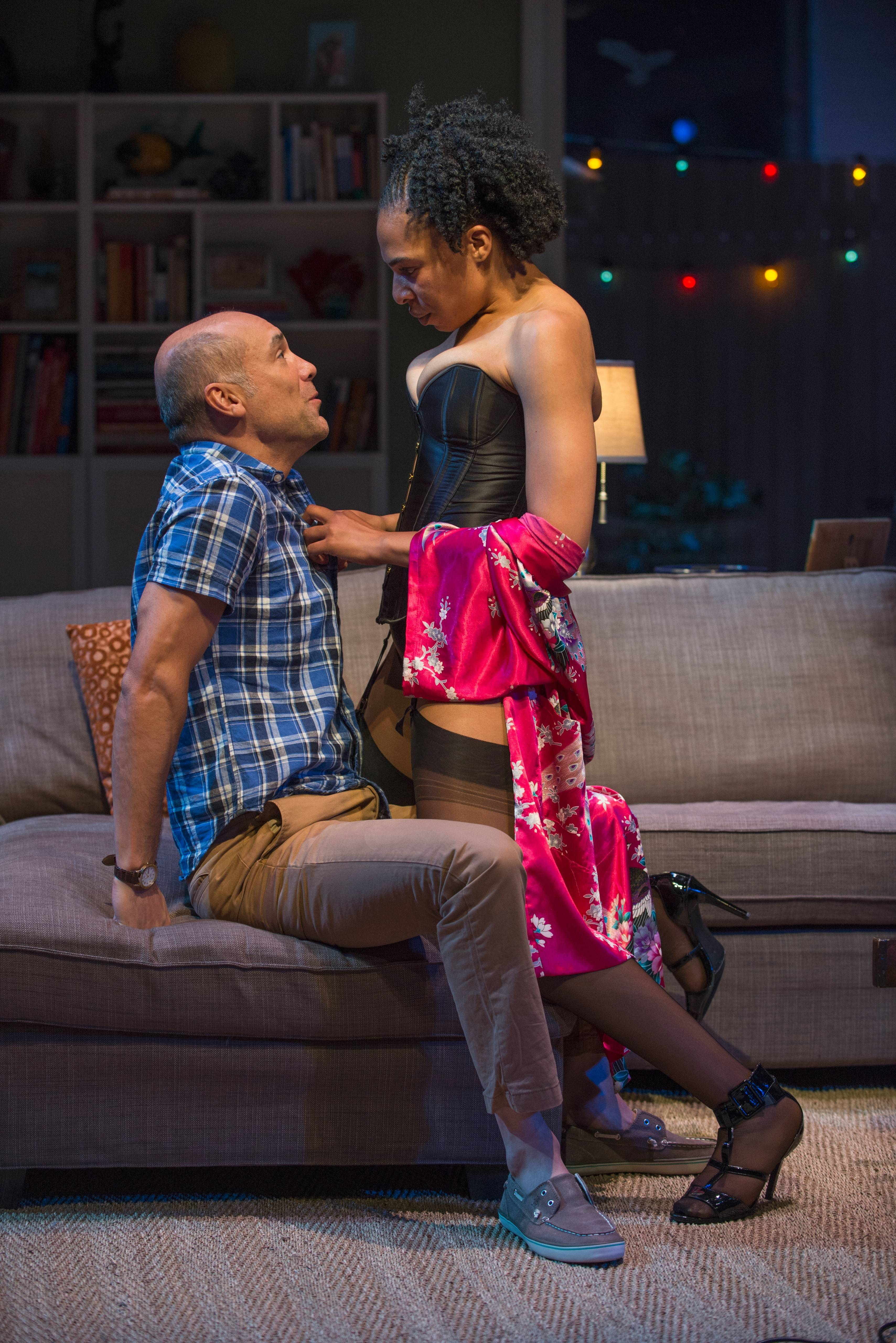 "Regine (Karen Aldridge) makes sexual overtures to Chris (Greg Stuhr) at a suburban swingers party in the world premiere of Bruce Norris' ""The Qualms"" at Steppenwolf Theatre Company in Chicago."