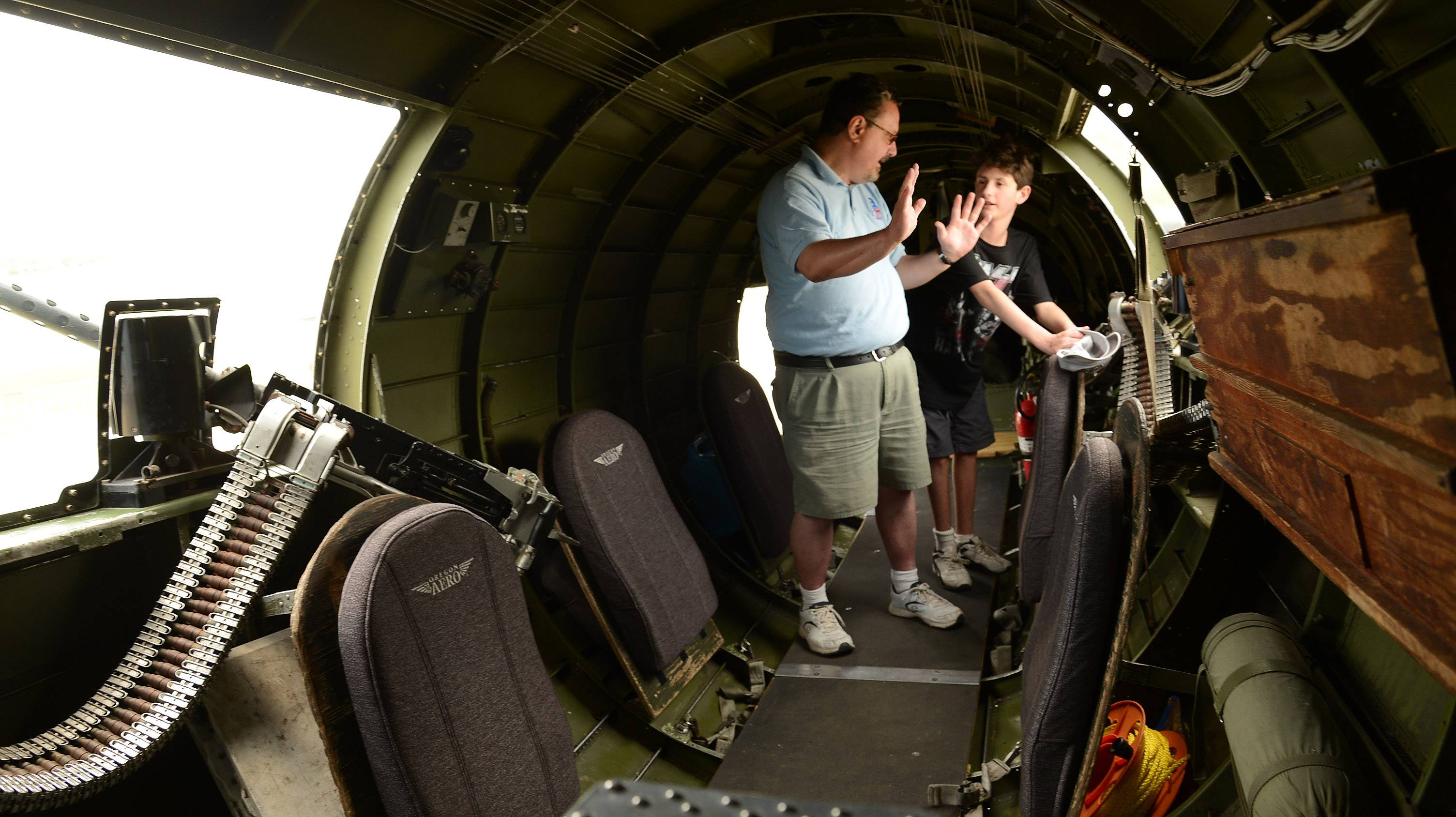 Mark Farina and his son Louis, right, tour the bomber.
