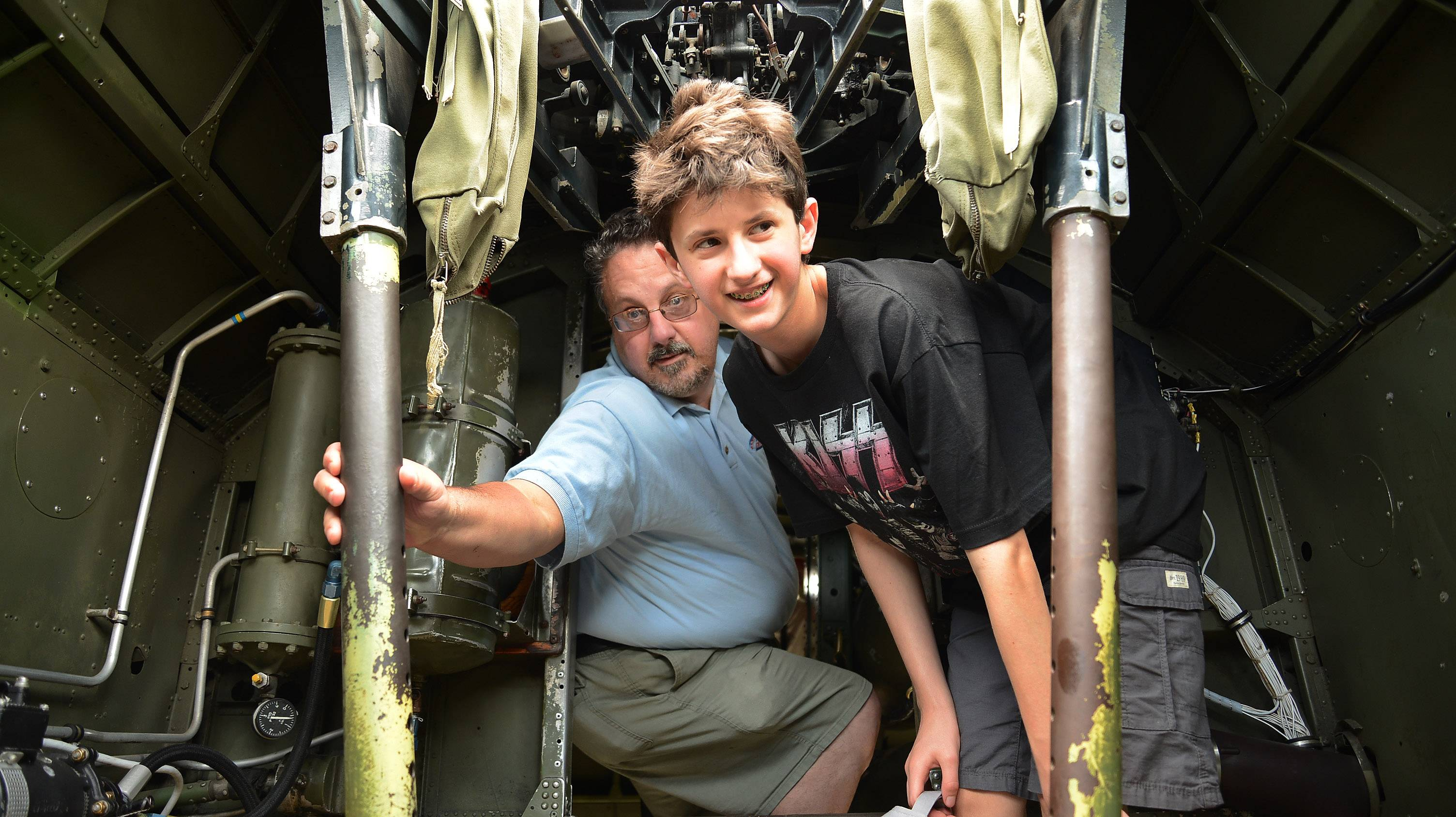Mark Farina shows his son Louis the B-17's interior Thursday.