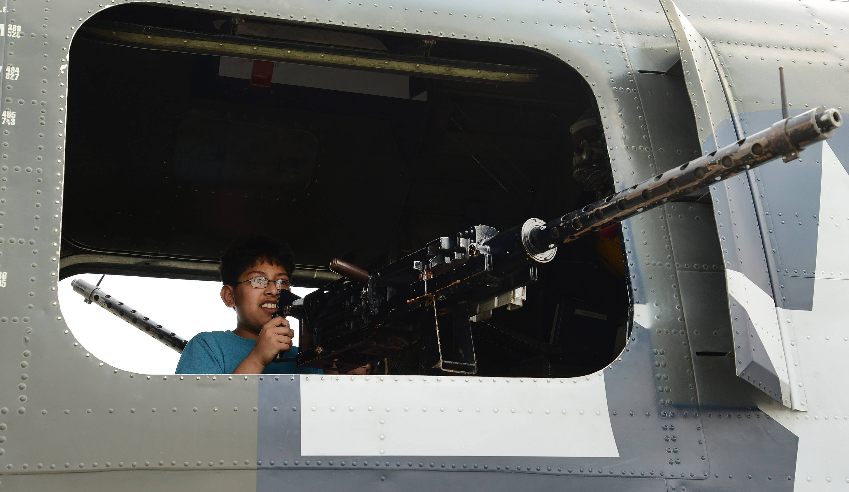 Sambuddha Ghosal, of Lincolnshire, tries out the guns on the B-24.