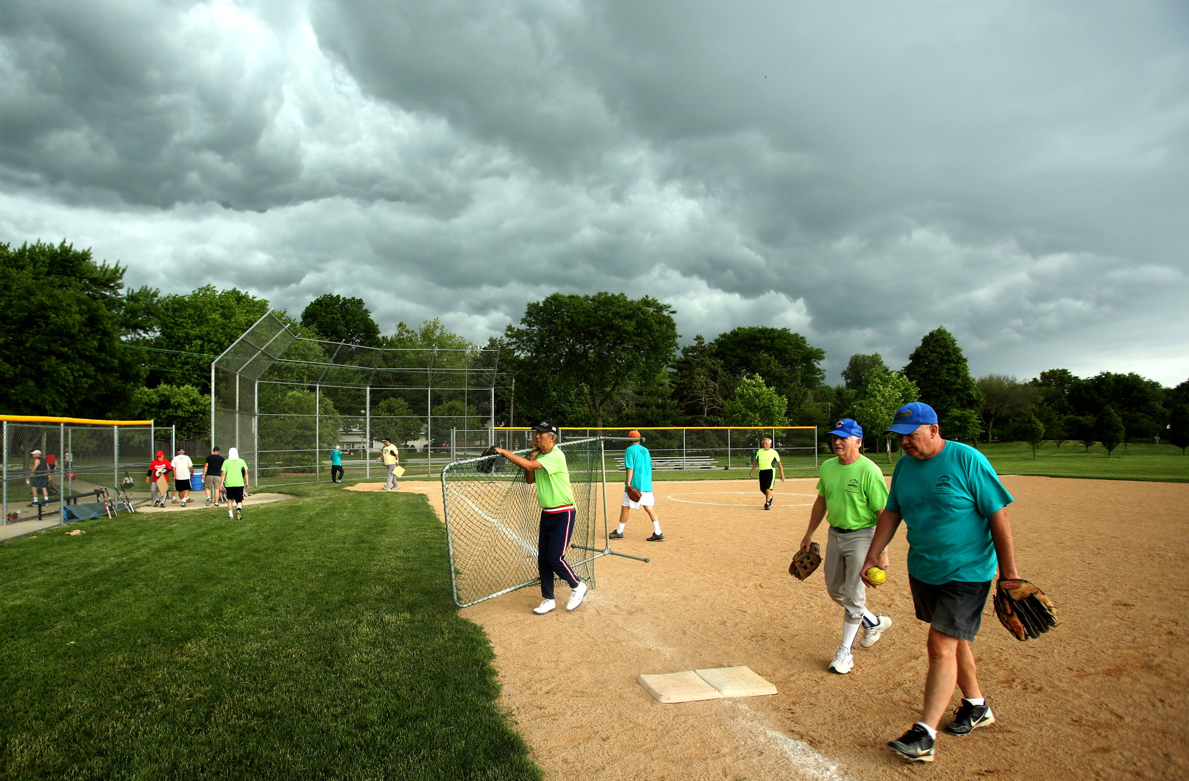 With severe thunderstorms threatening the area, a Naperville Men's Senior Softball League game is canceled at Gartner Park. Games are played Monday, Wednesday and Friday mornings.