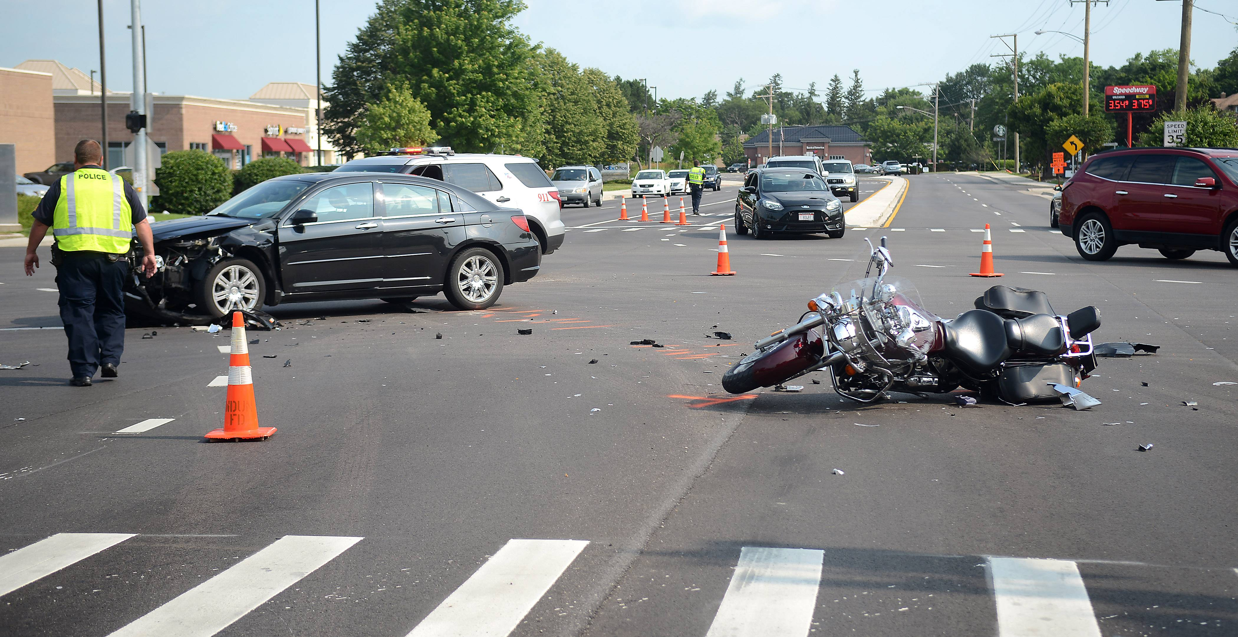 Police investigate the scene of a car and motorcycle crash Friday morning at the intersection of routes 72 and 31 in West Dundee.