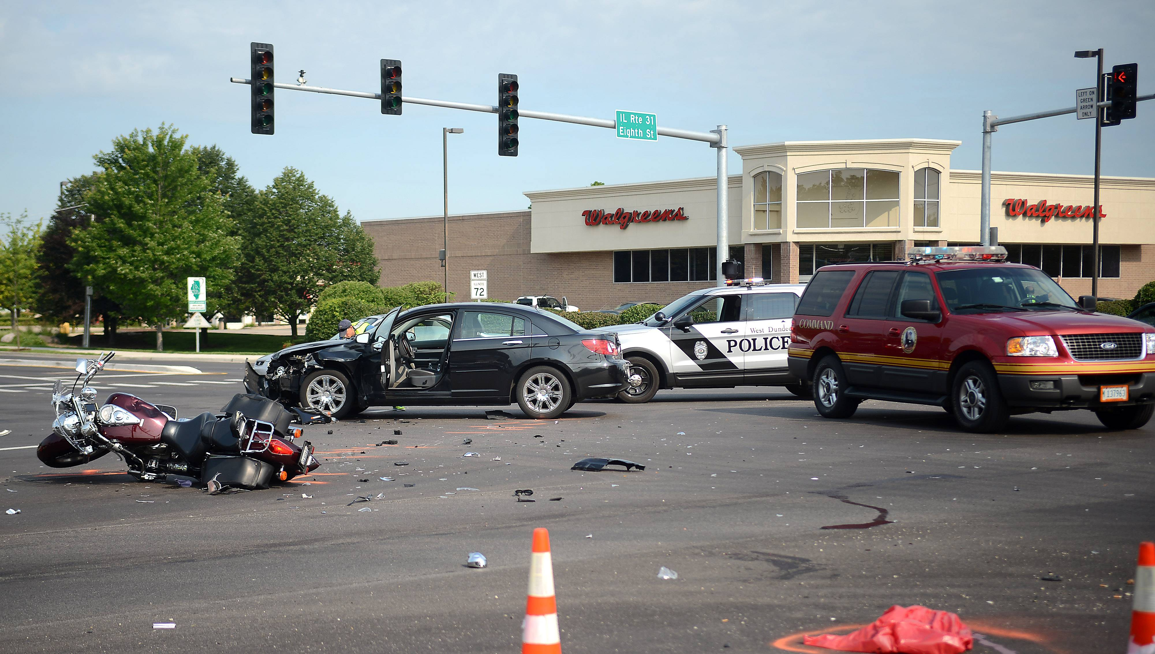 Jiffy Lube technician Mackenzy Krogh said the driver of a motorcycle was hurled about 15 to 20 feet after his motorcycle collided with a Chrysler Sebring Friday at routes 72 and 31 in West Dundee.
