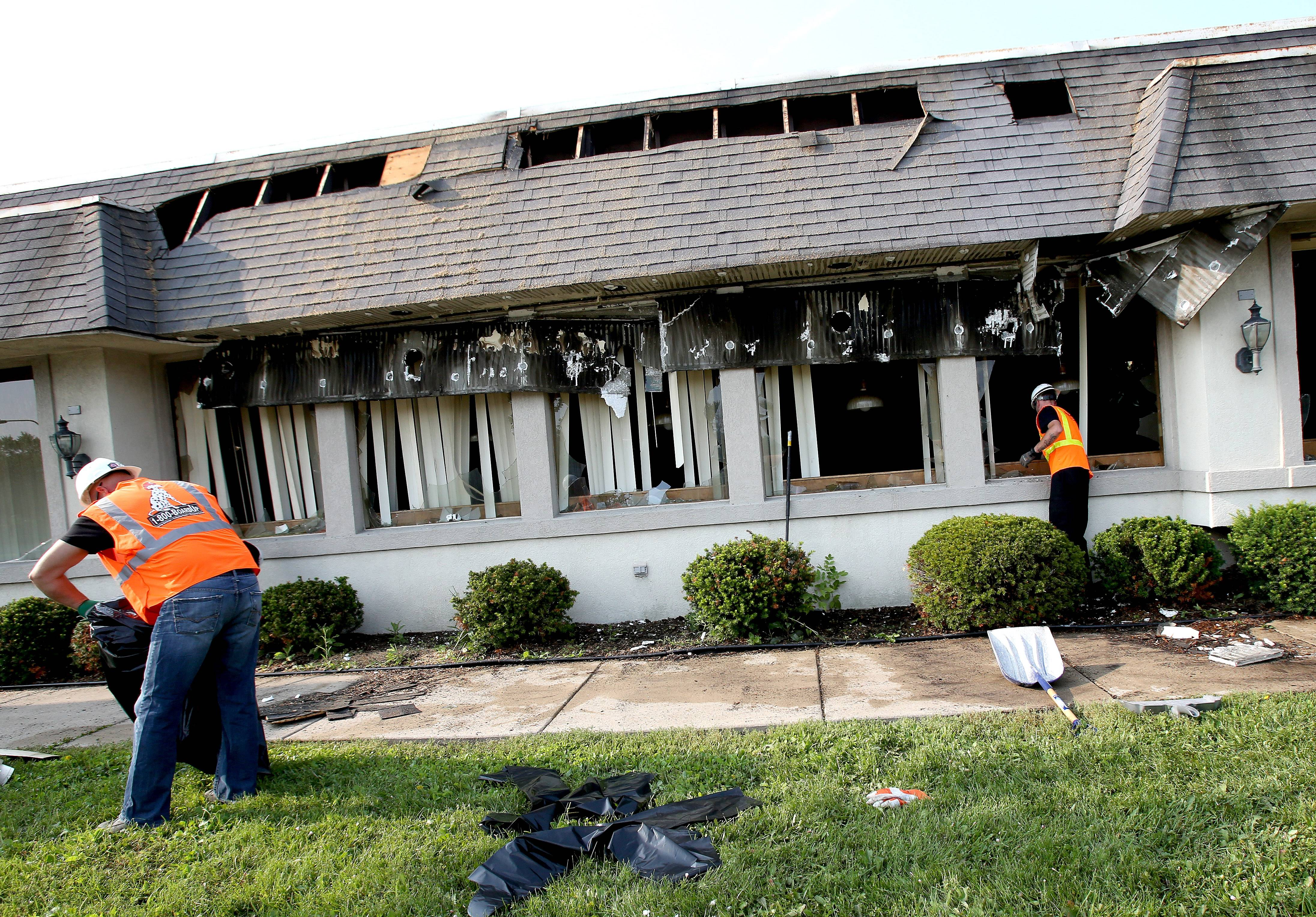 Crews clean up after an overnight fire caused extensive damage to Grandma Sally's in Naperville.