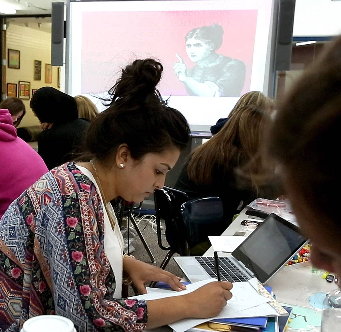 Eman Suleman, a kindergarten teacher at Ranch View Elementary in Naperville Unit District 203, works on a writing exercise Thursday as educators wrap up a four-day training session about how to teach writing under the new Common Core standards.