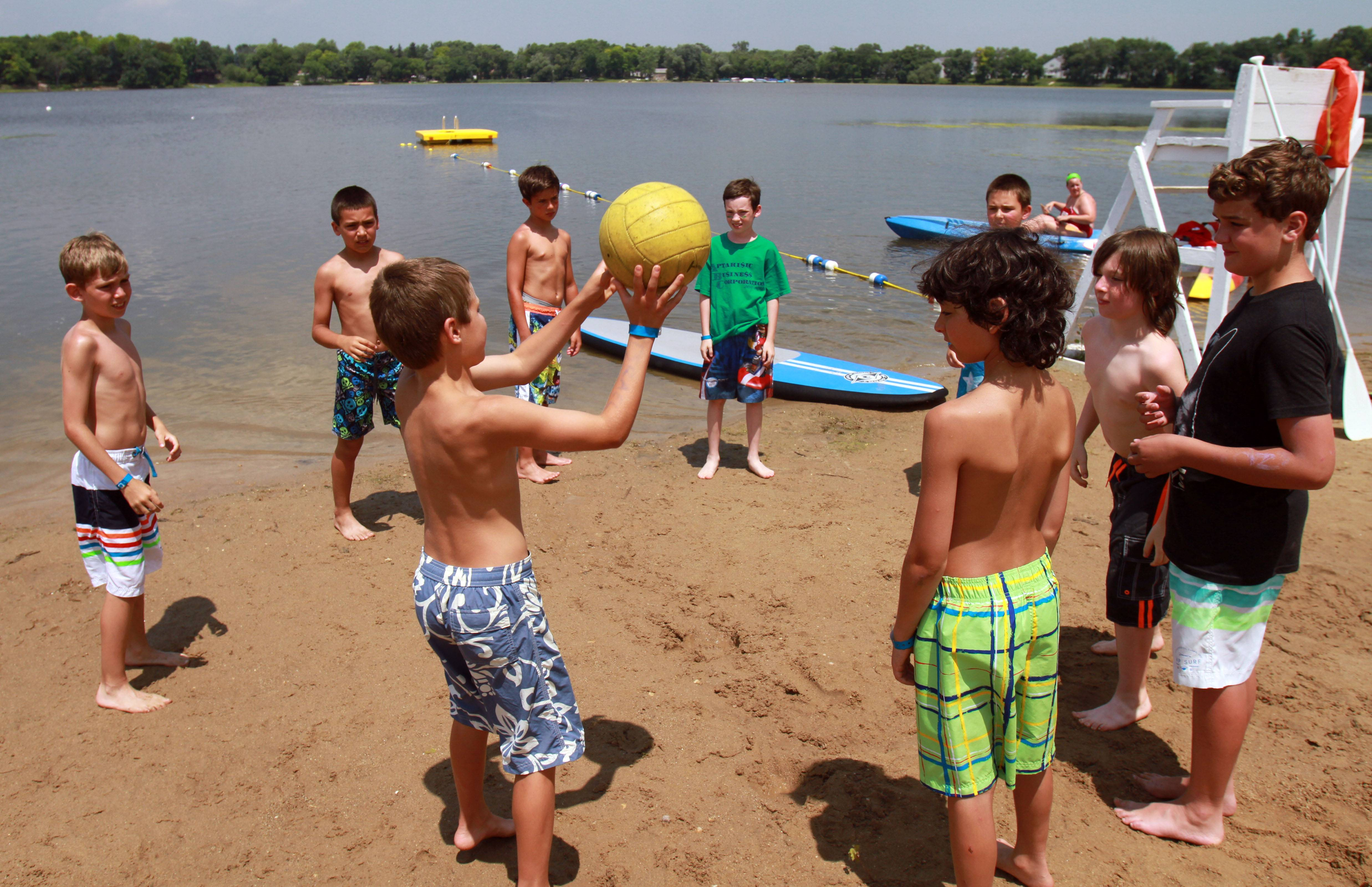 Boys play a game on the beach at Camp Henry Horner in Ingleside. The camp is celebrating its 100th year with an alumni anniversary celebration on July 20.