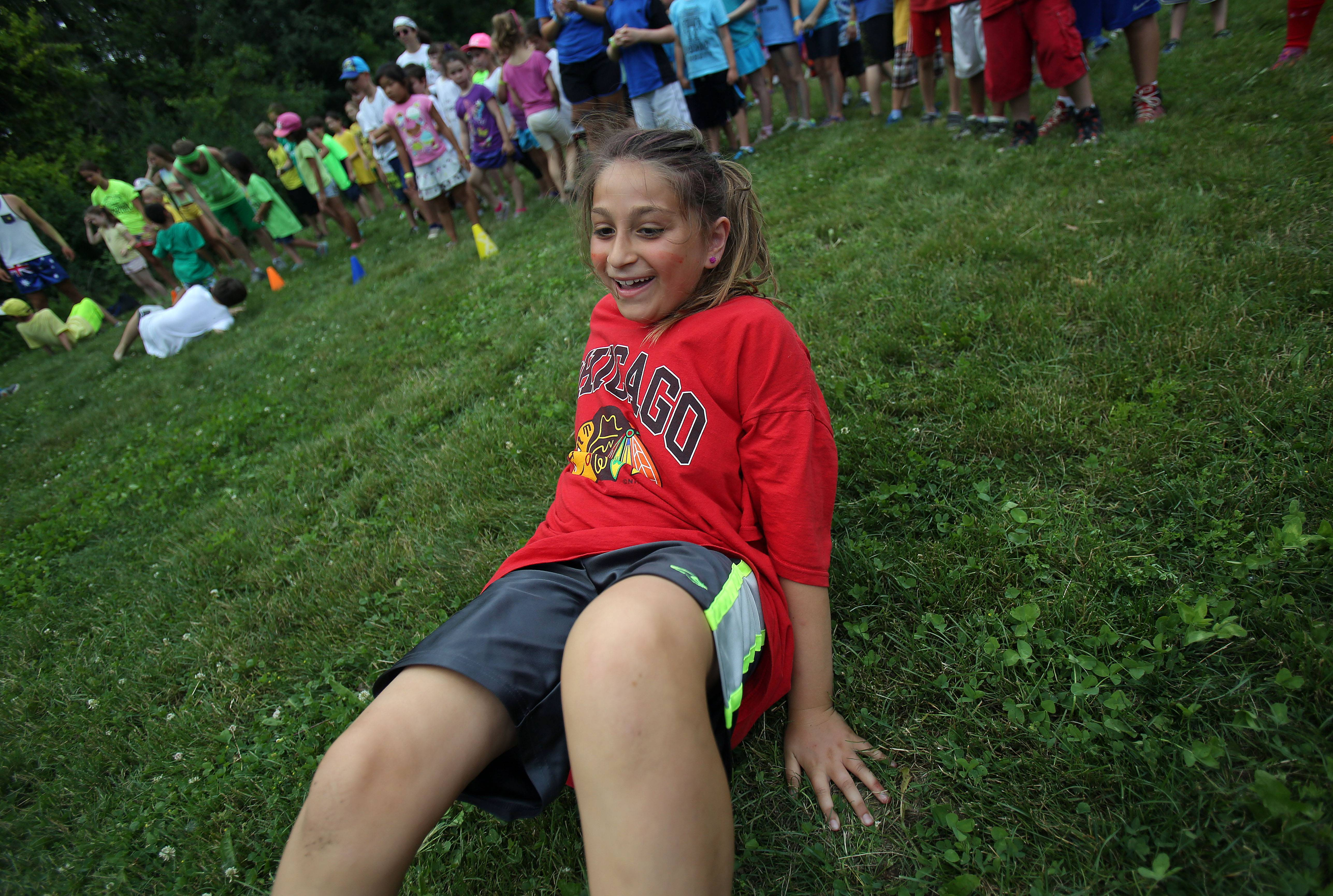 Mara Feldman, 8, of Buffalo Grove participates in a crab walk relay at Camp Henry Horner in Ingleside. The camp is celebrating its 100th year with an alumni anniversary celebration on July 20.