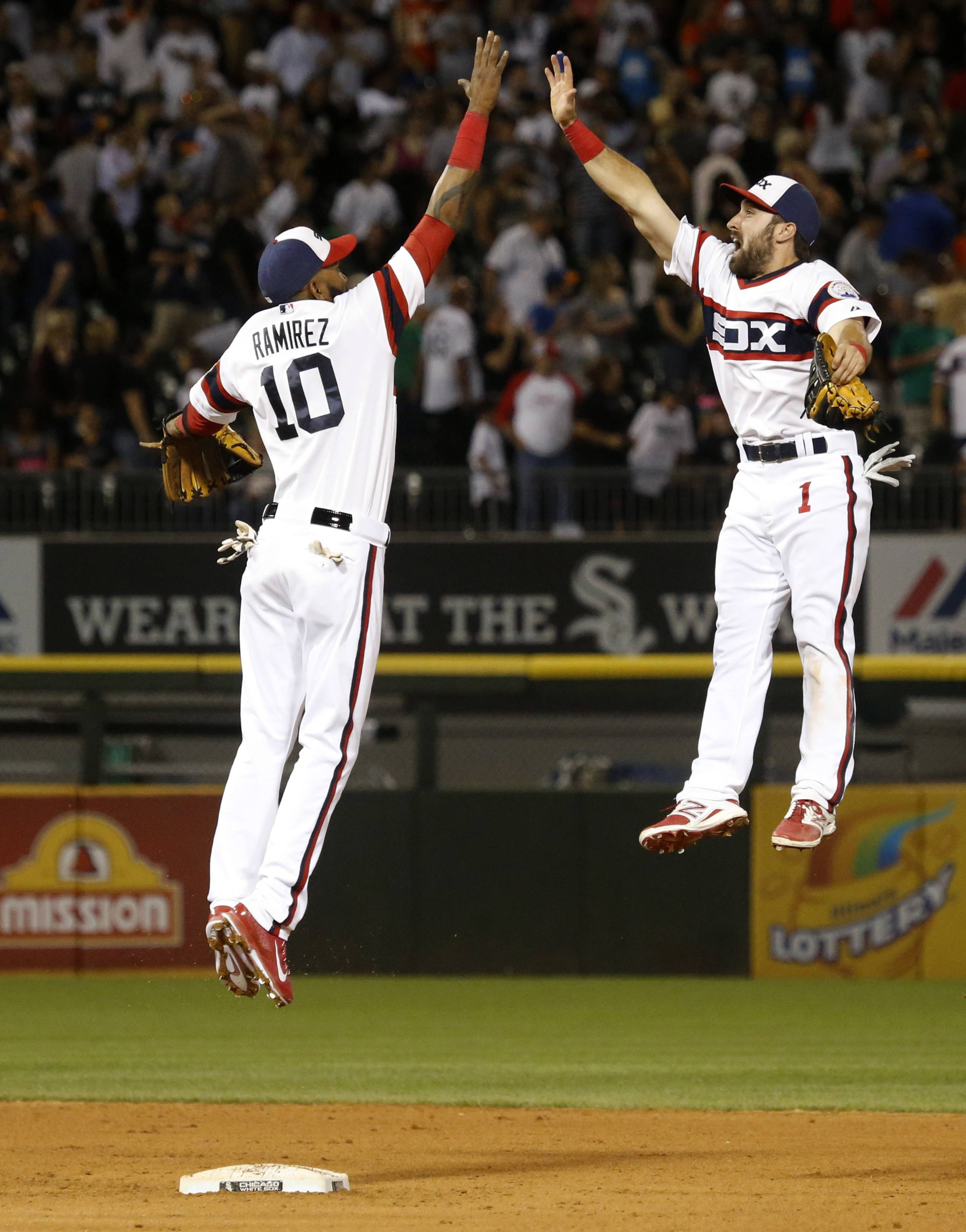Alexei Ramirez, left, and Adam Eaton celebrate the White Sox' victory over the Astros on Friday at U.S. Cellular Field.