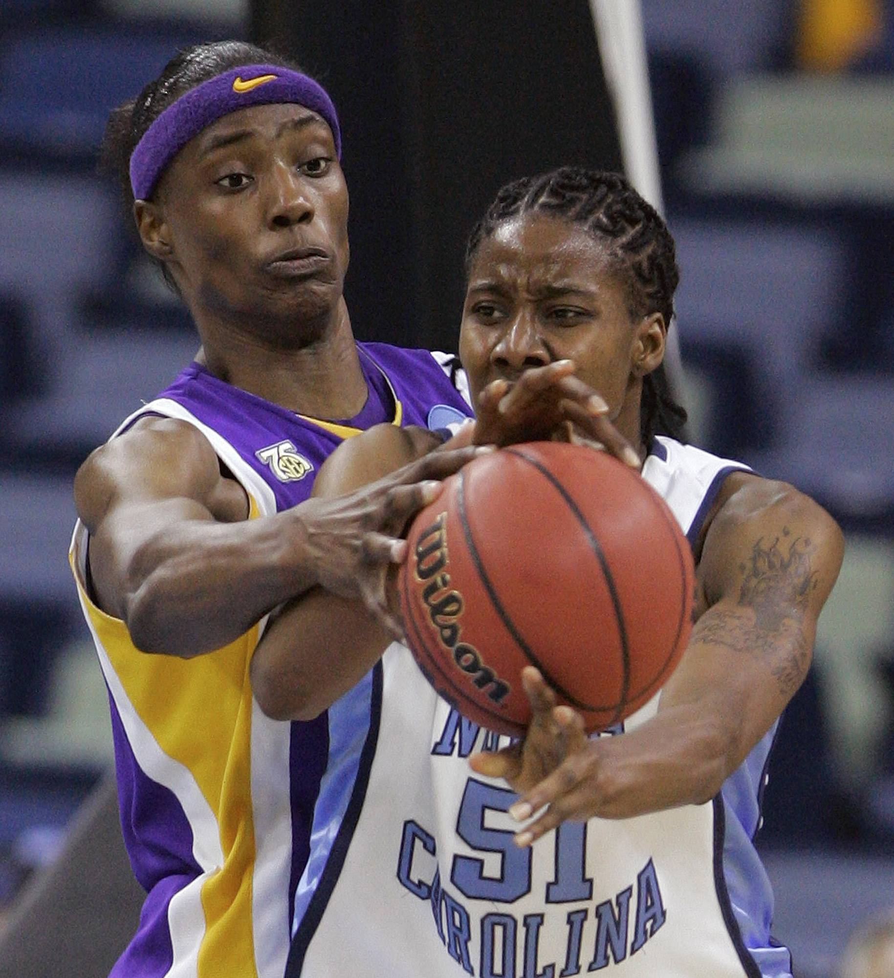 LSU's Sylvia Fowles, left, reaches for the ball against North Carolina's Jessica Breland in NCAA women's basketball tournament action. Fowles and Breland are now teammates on the Chicago Sky.