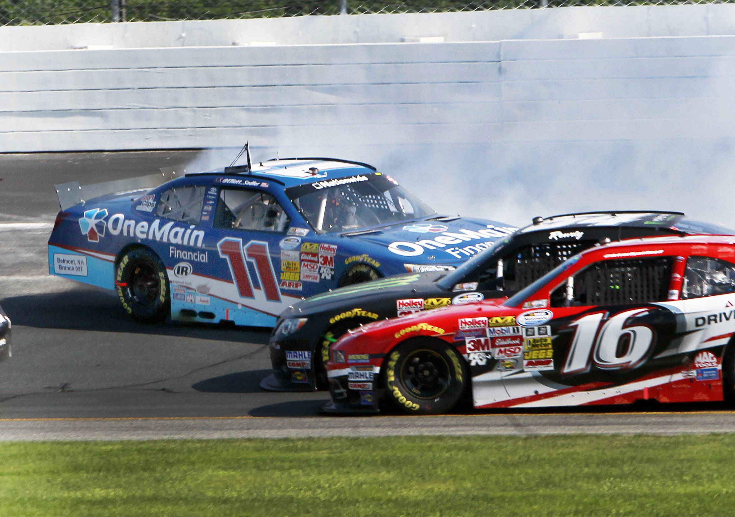 Ryan Reed (16) and Kyle Busch slide under Elliott Sadler during the NASCAR Nationwide Series auto race at New Hampshire Motor Speedway on July 12. Sadler qualified for the $100,000 Dash4Cash at Chicagoland Speedway, which hosts the EnjoyIllinois300.com race on Saturday.