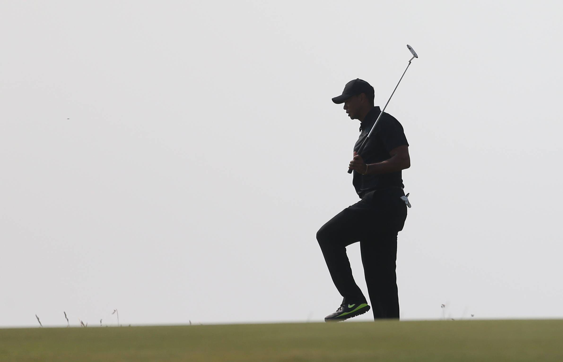 Tiger Woods prepares to putt on the 13th green Friday during the second round of the British Open at the Royal Liverpool golf club in Hoylake, England.
