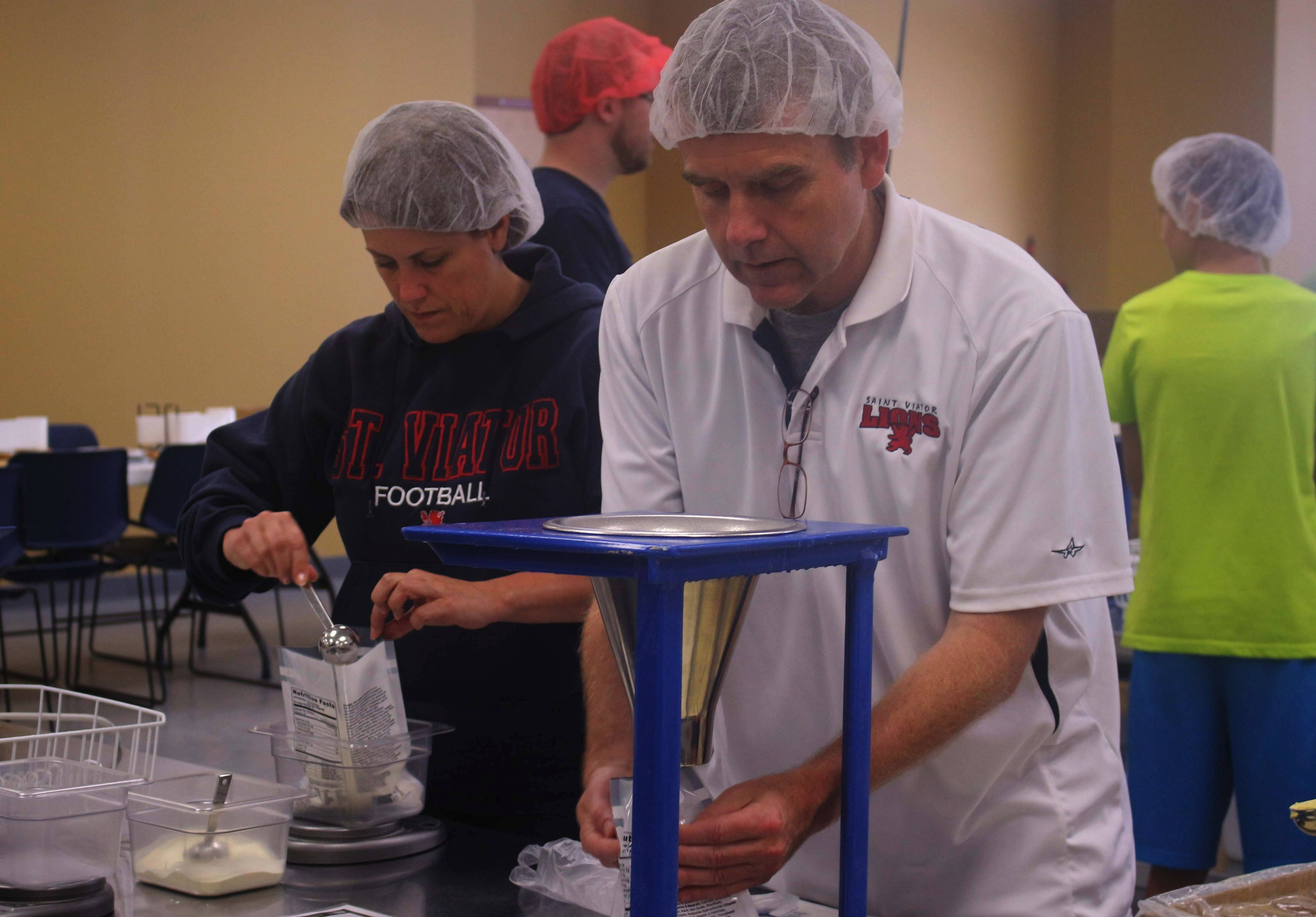 St. Viator High School President the Rev. Corey Brost worked alongside his students and staff.
