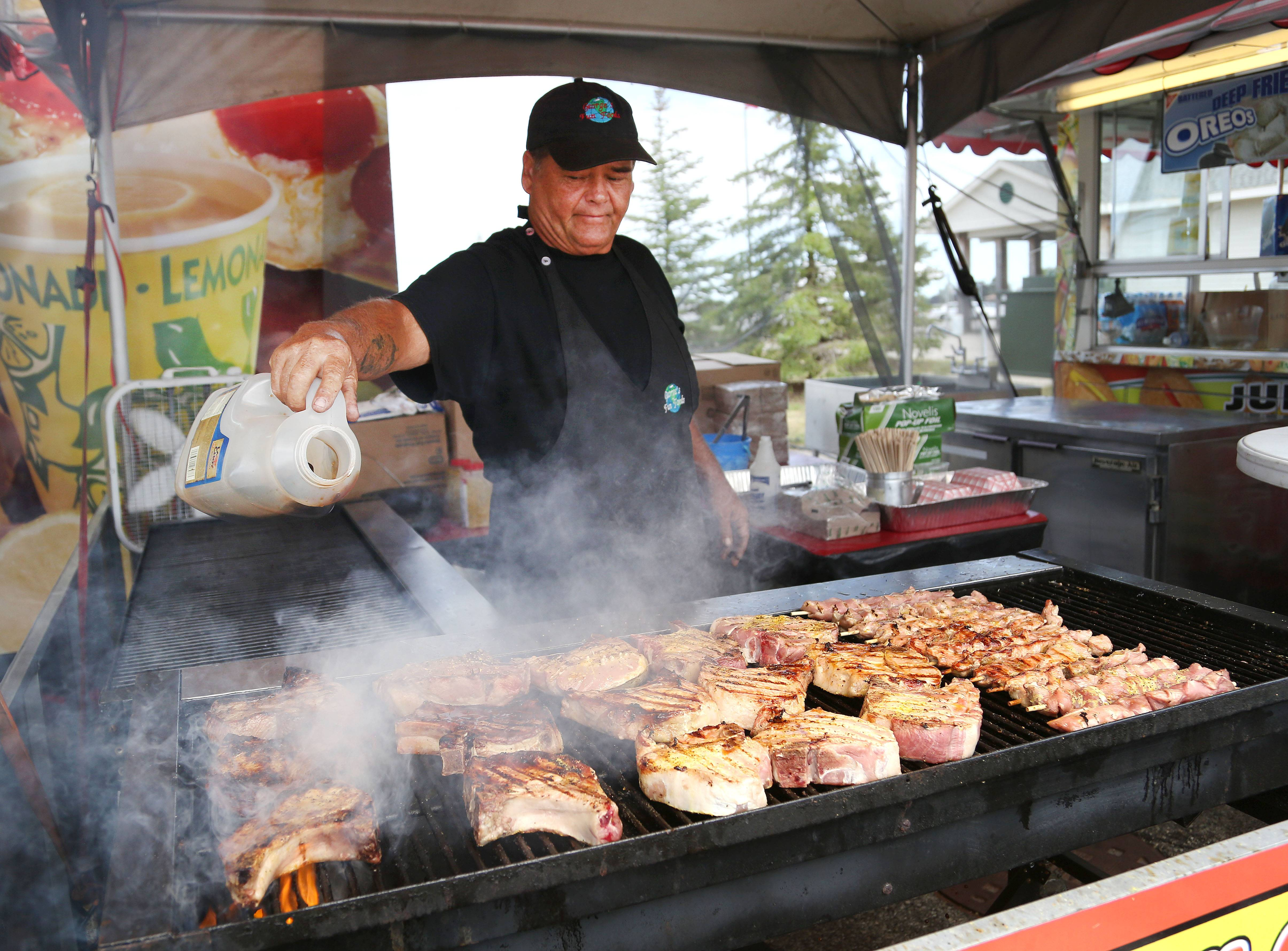 Sam Perkins cooks pork chops during last year's Lake County Fair in Grayslake.