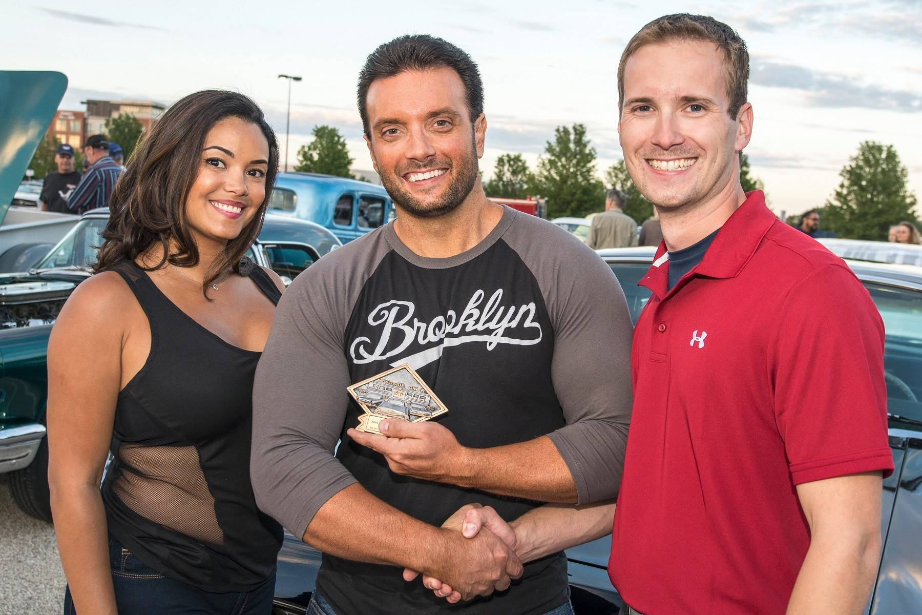 Louis Modesti of Glenview, center, and his girlfriend Christina Santiago came to the show and earned Matt Avery's Pick. Modesti shared his story of why the 1965 Lincoln Continental he drives is so special to him.