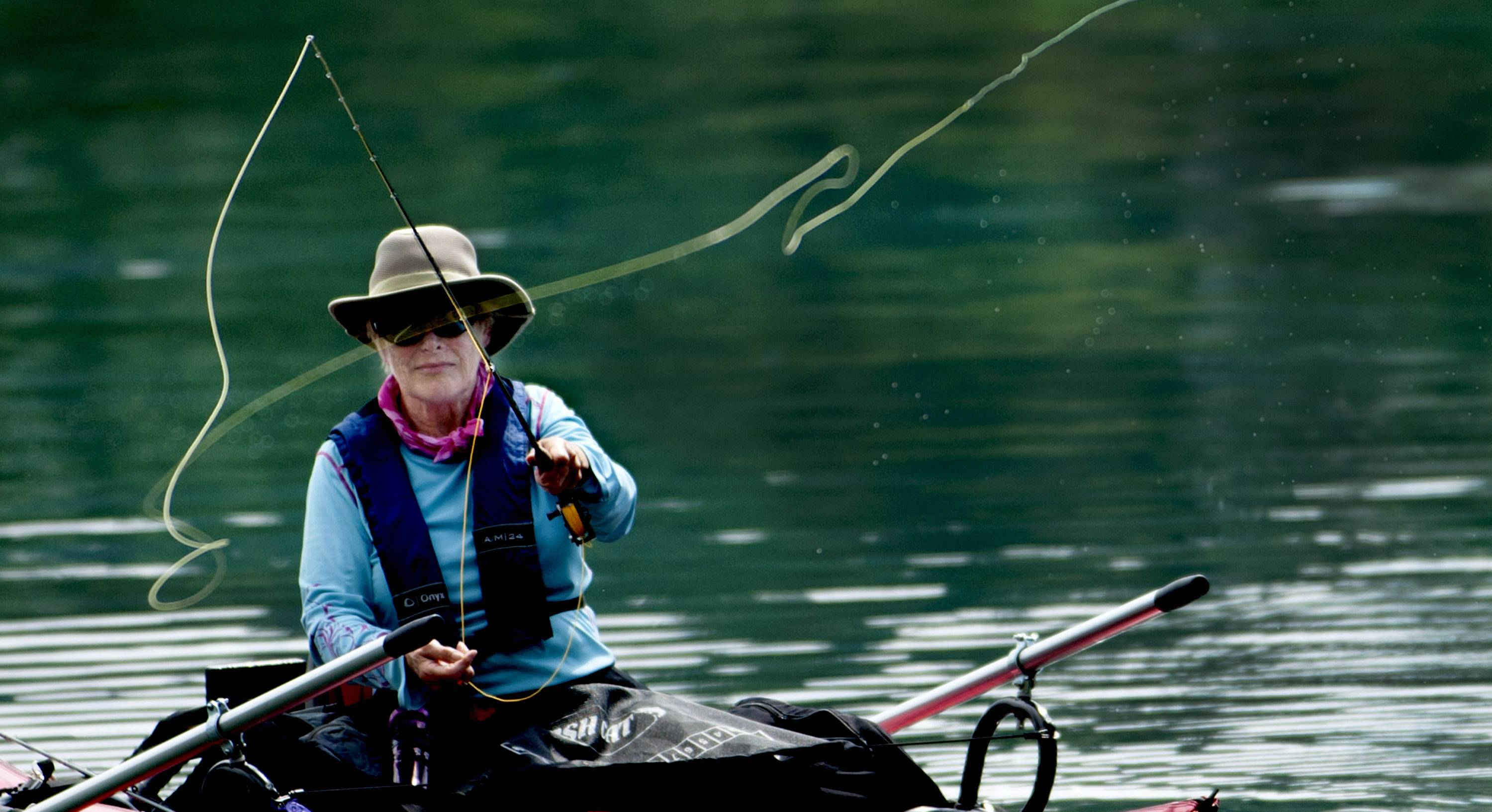 Joanie Dwyer of Coeur d'Alene, Idaho fly-fishes Monday from her pontoon on Hayden Lake in Hayden, Idaho.