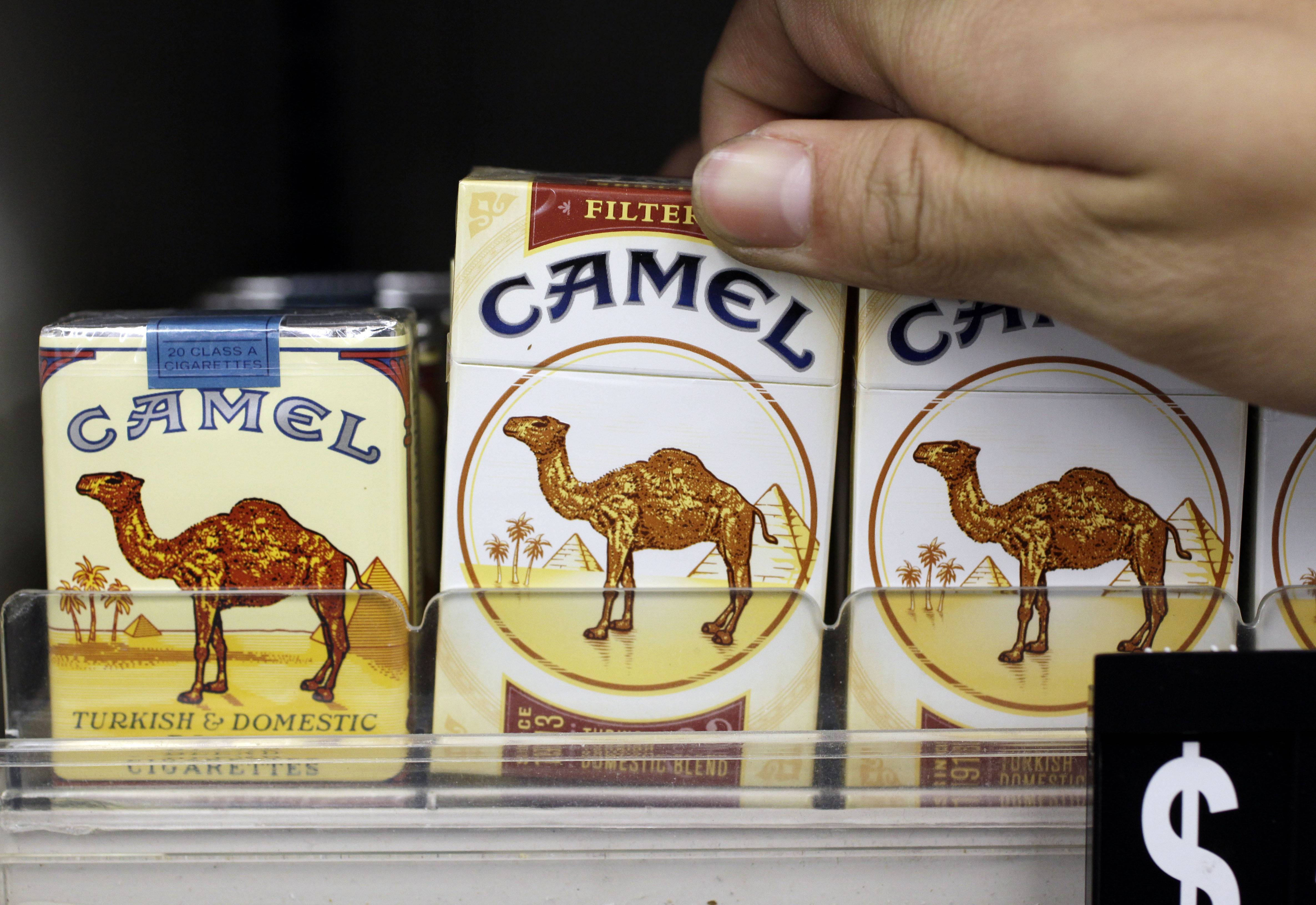 Camel cigarettes, a Reynolds American product, are on display at a liquor store in Palo Alto, Calif. Cigarette maker Reynolds American Inc. is planning to buy rival Lorillard Inc. for about $25 billion in a deal to combine two of the nation's oldest and biggest tobacco companies.
