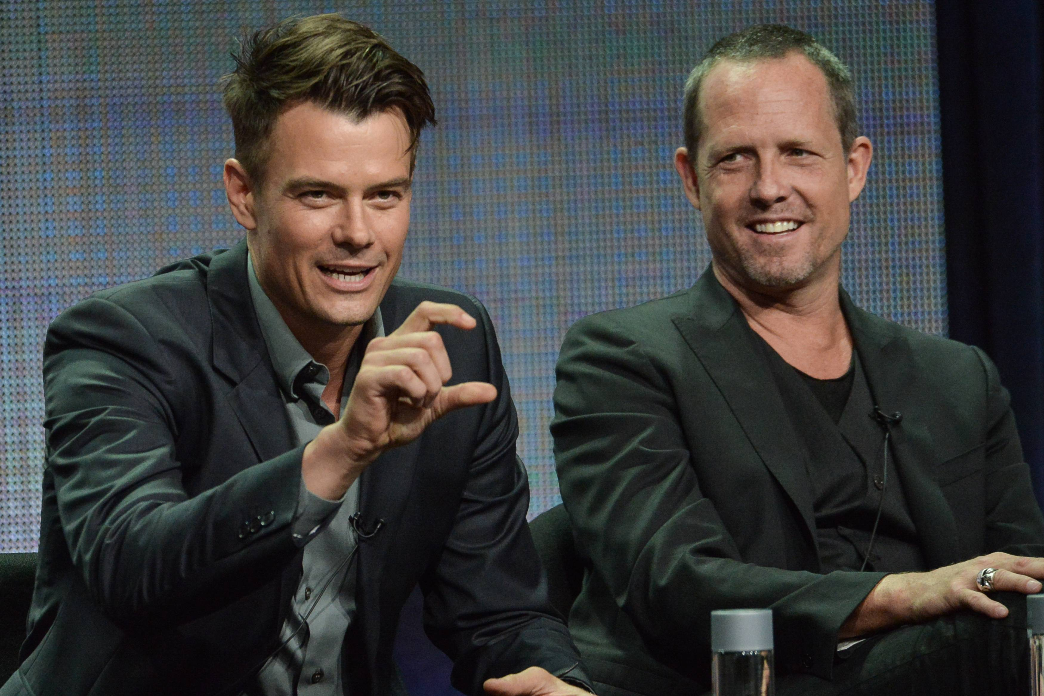 "Josh Duhamel, left, and Dean Winters speak onstage during the ""Battle Creek"" panel at the CBS 2014 Summer TCA held at the Beverly Hilton Hotel on Thursday, July 17, 2014, in Beverly Hills, Calif."