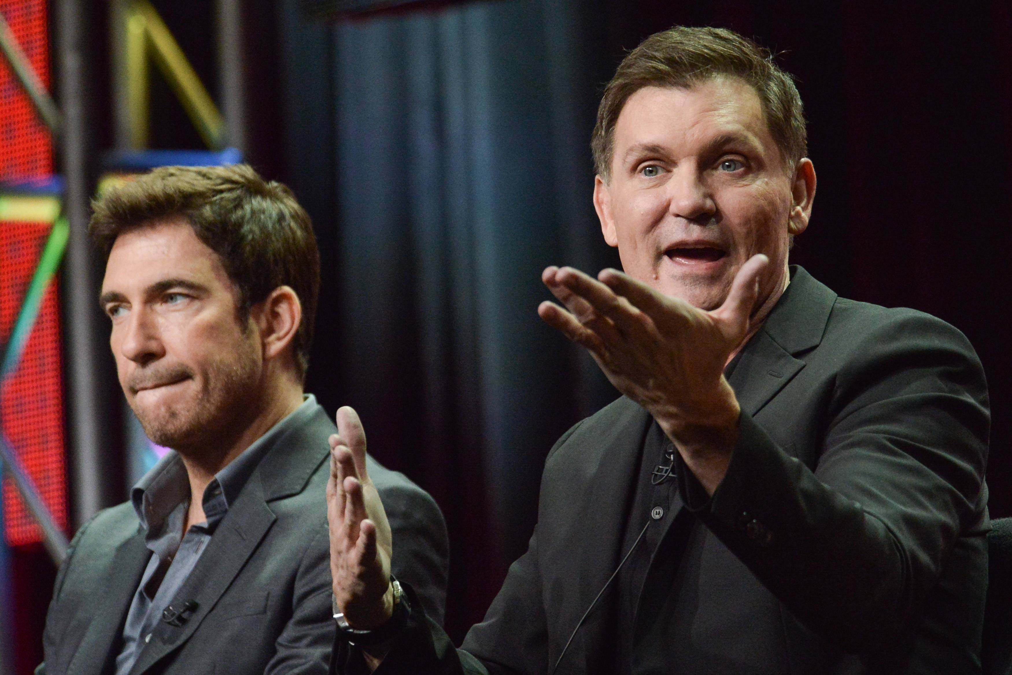 "Dylan McDermott, left, and Kevin Williamson speak onstage during the ""Stalker"" panel at the CBS 2014 Summer TCA held at the Beverly Hilton Hotel on Thursday, July 17, 2014, in Beverly Hills, Calif."