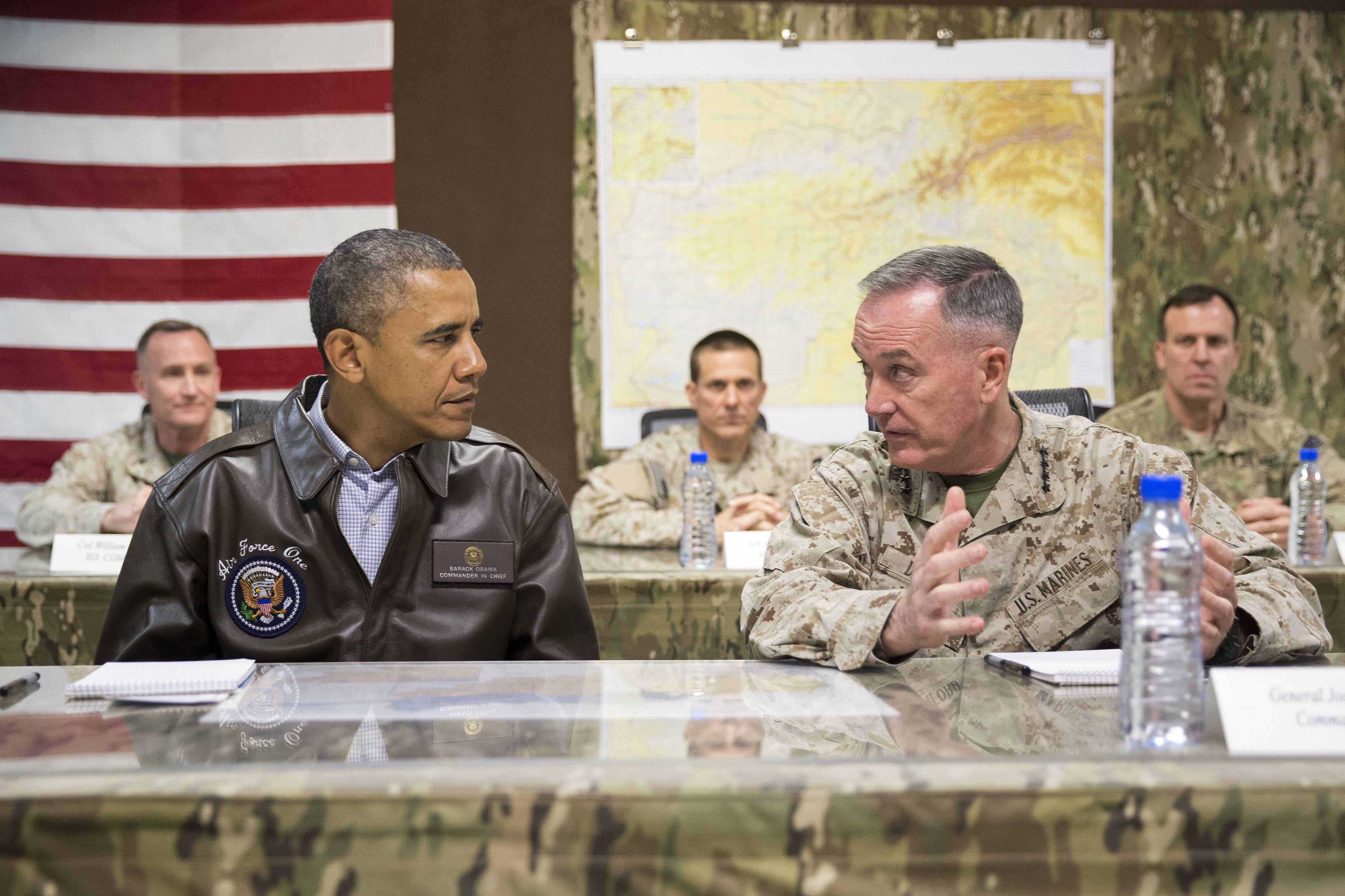 President Barack Obama as he is briefed by Marine General Joseph Dunford, commander of the US-led International Security Assistance Force (ISAF), right, after arriving at Bagram Air Field for an unannounced visit north of Kabul, Afghanistan. The Afghan election crisis and unraveling of Iraq has lawmakers and others thinking President Barack Obama should re-think his decision to withdrawal virtually all U.S. troops from Afghanistan by the close of 2016.