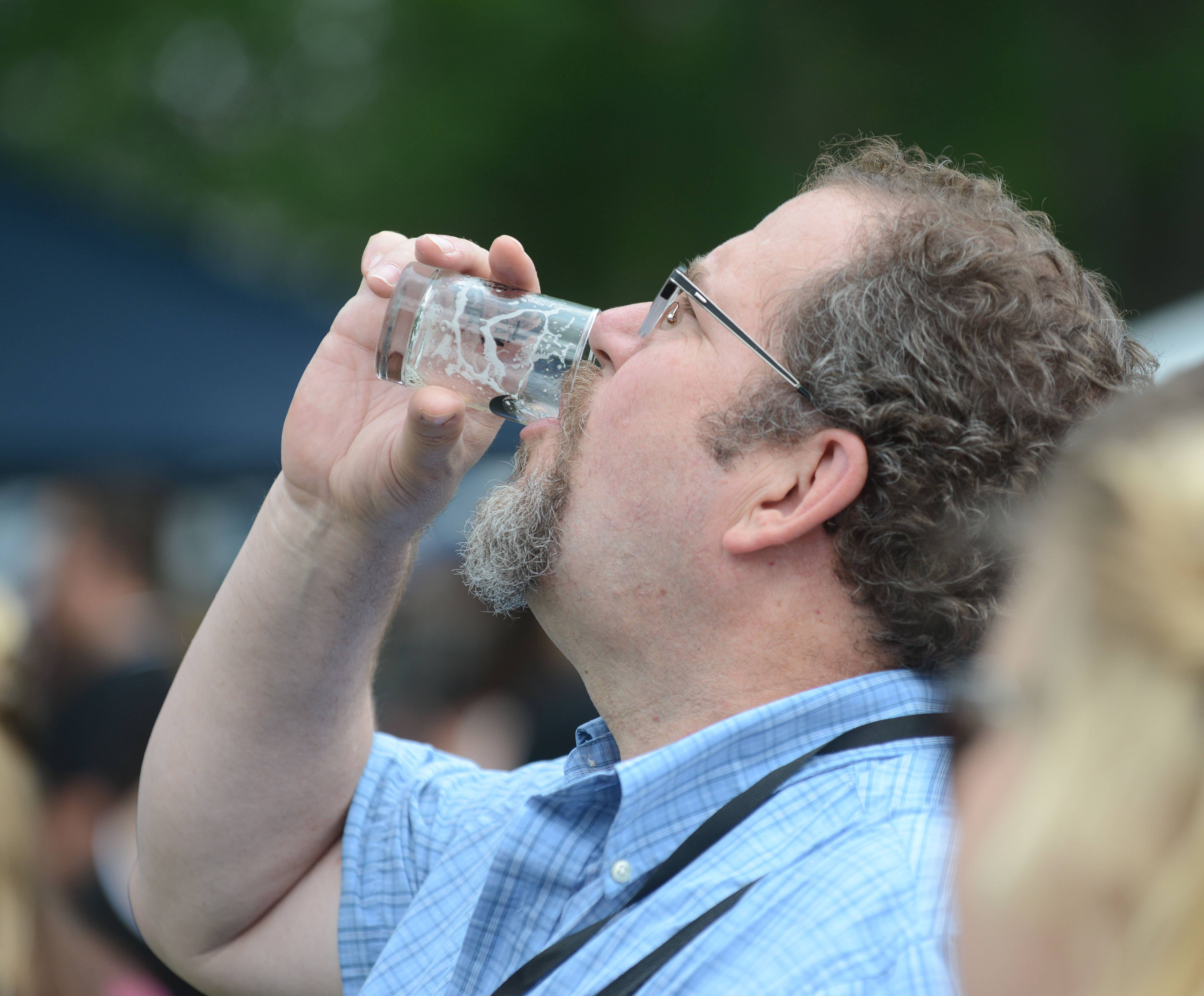 Kelly Fullerton of Naperville enjoys his beer to the last drop. The Naperville Ale Fest Saturday at Naper Settlement featured more than 180 beers from craft breweries around the country. A portion of the proceeds will benefit Naper Settlement and the Naperville Heritage Society.