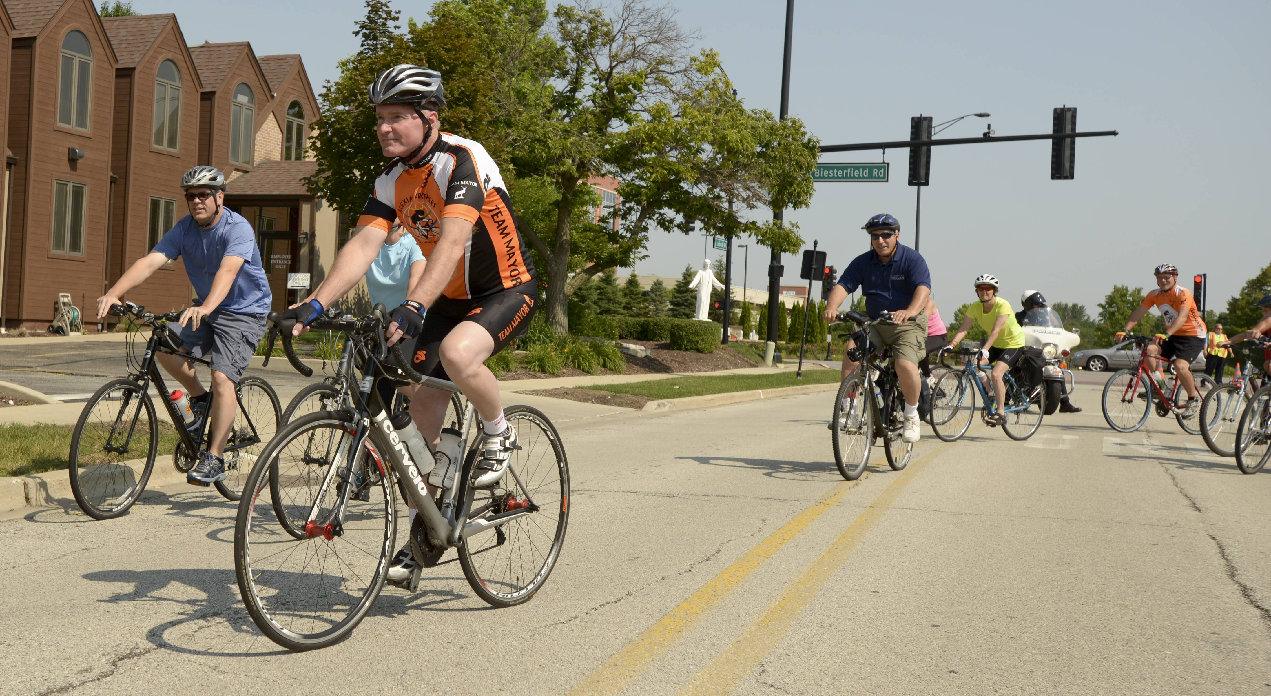 Elk Grove Village Mayor Craig Johnson leads cyclists around the village Saturday on a ride to promote cycling. The ride was run by the Friends of Cycling in Elk Grove.