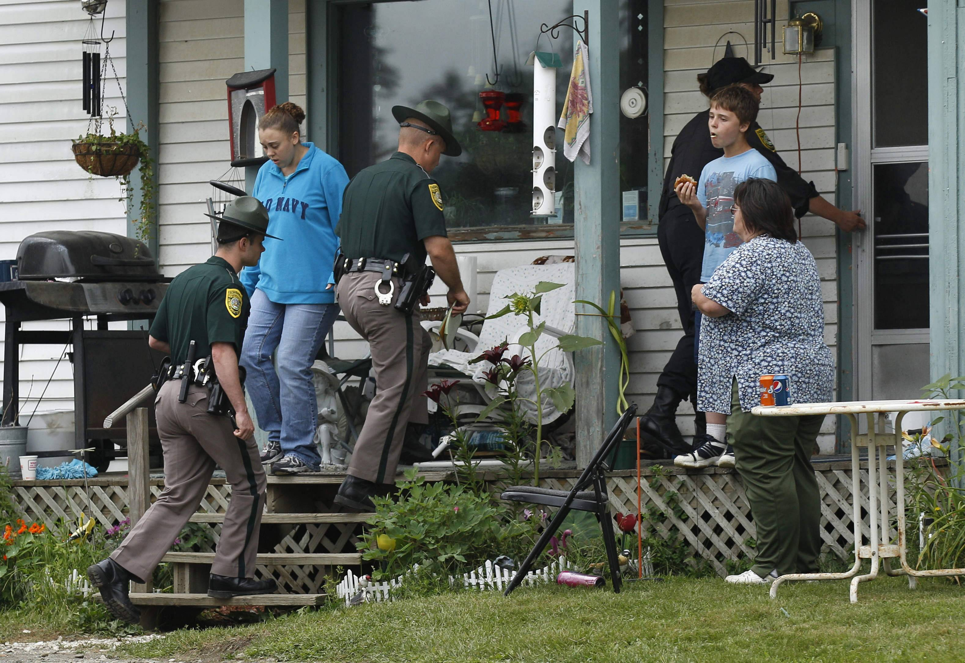 On Wednesday July 27, 2011, New Hampshire State Police Troopers enter the family home of Celina Cass in Stewartstown, N.H. It has been almost three years since the 11-year-old body was found in the Connecticut River. Investigators remain silent about the details of Celina's death except to call it a homicide.