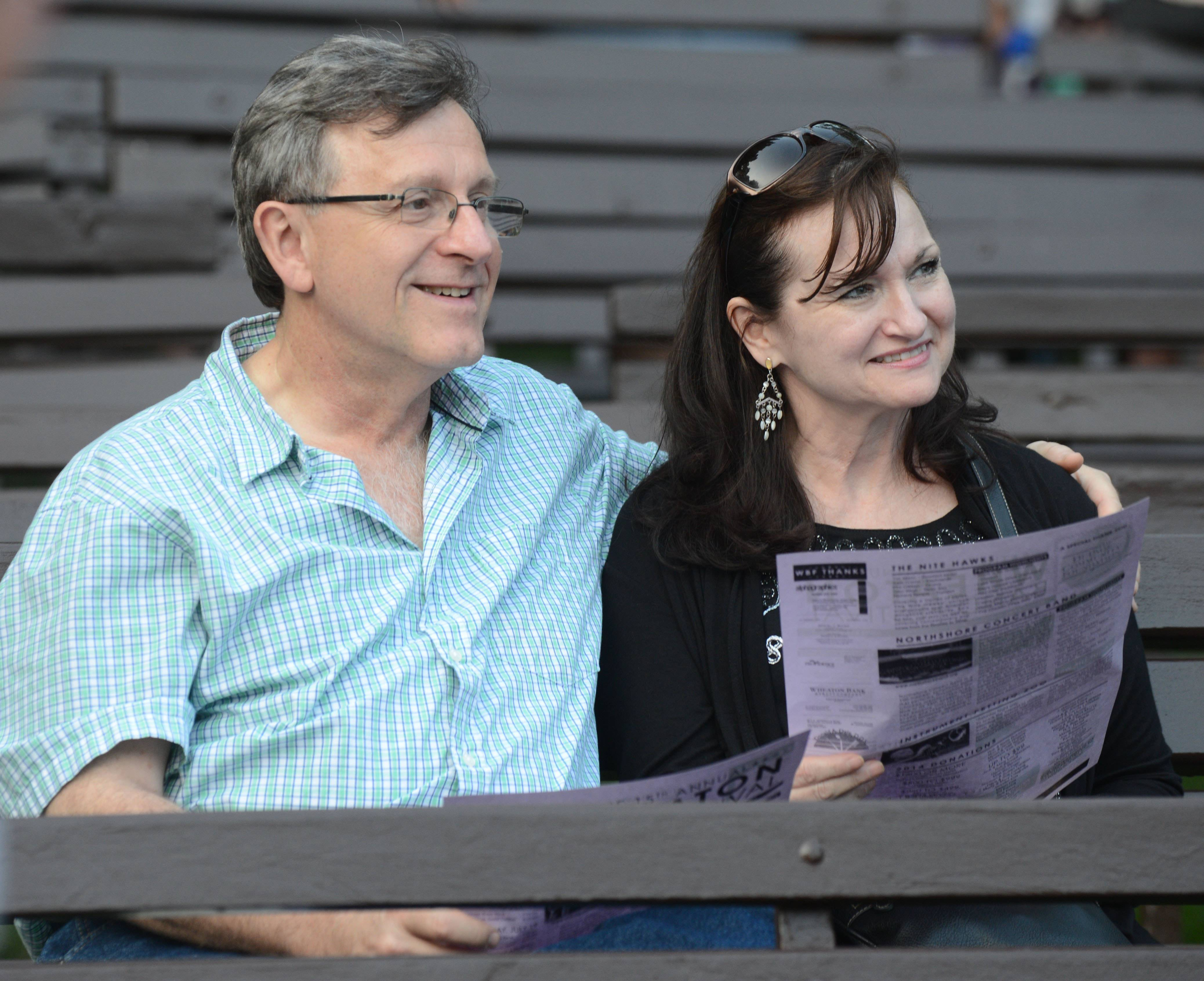Paul Michna/pmichna@dailyherald.com Marc and Denise Donatelle of Bartlett are all smiles during the 15th annual Wheaton Band Festival. The fest opened Friday night in Memorial Park.