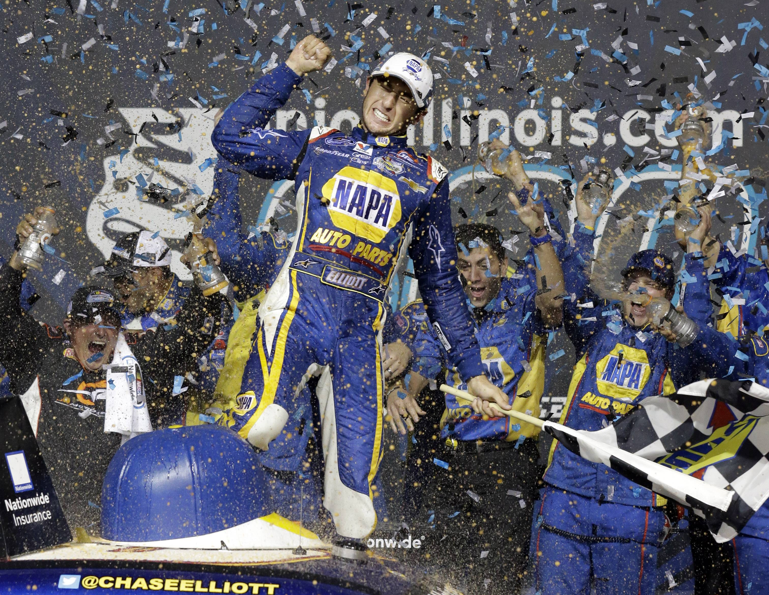 Chase Elliott (9) celebrates with teammates in Victory Lane after winning the NASCAR Nationwide Series auto race Saturday at Chicagoland Speedway in Joliet.