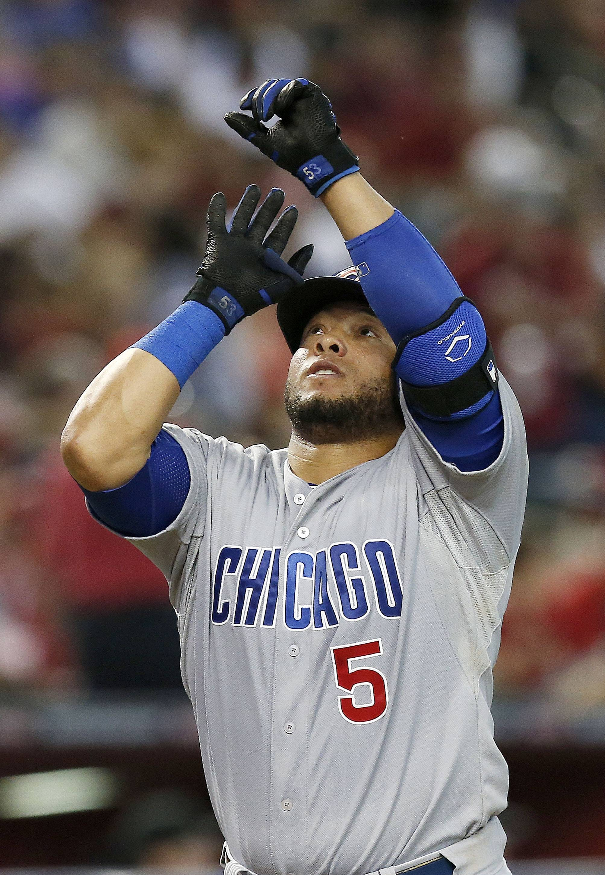 The Cubs' Welington Castillo celebrates his home run against the Arizona Diamondbacks during the fourth inning Saturday's game in Phoenix. The Cubs lost 9-3.