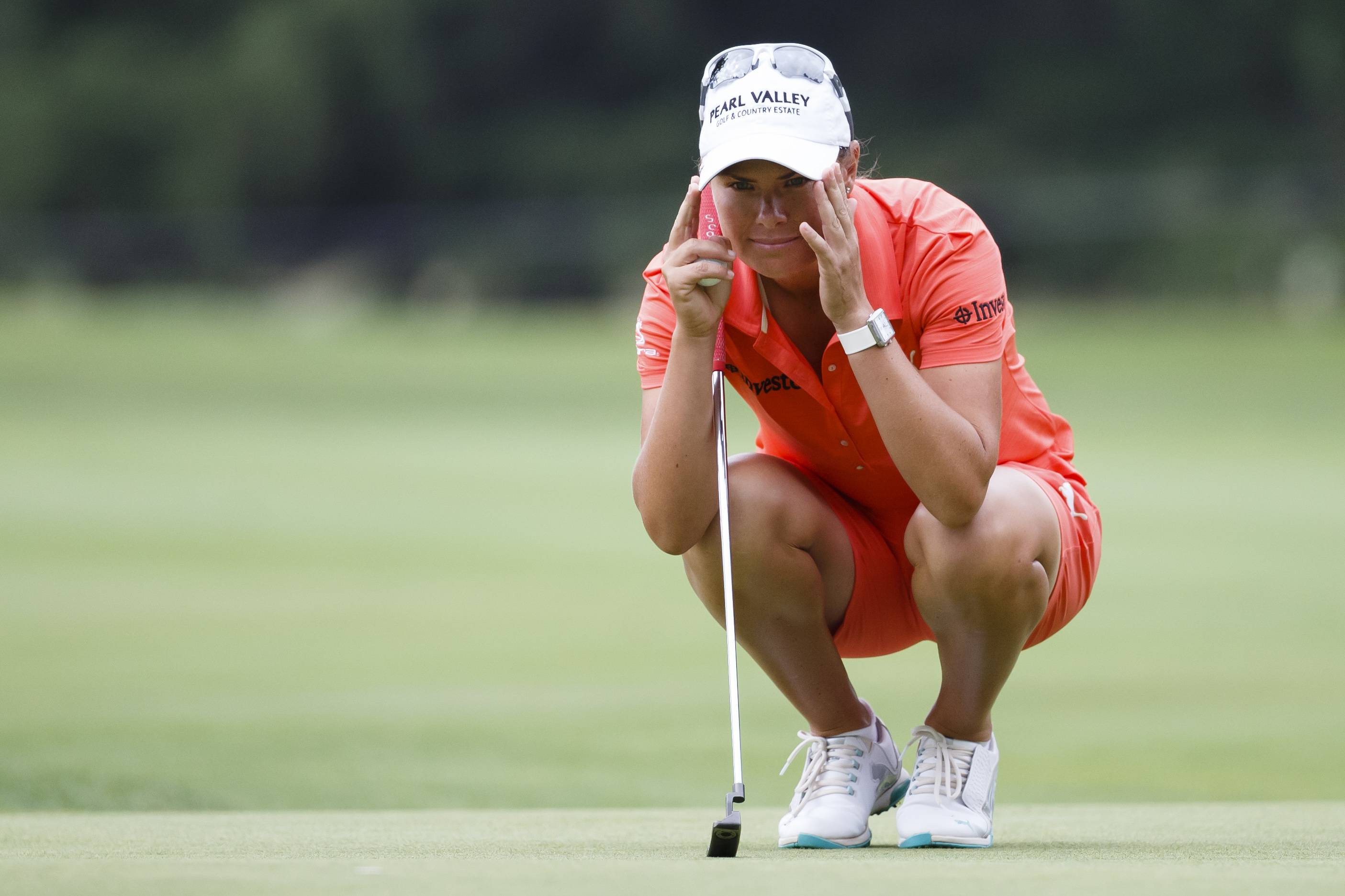Lee-Anne Pace, of South Africa, lines up a putt on the 17th green during the third round of the Marathon Classic LPGA golf tournament at Highland Meadows Golf Club in Sylvania, Ohio, Saturday, July 19, 2014.