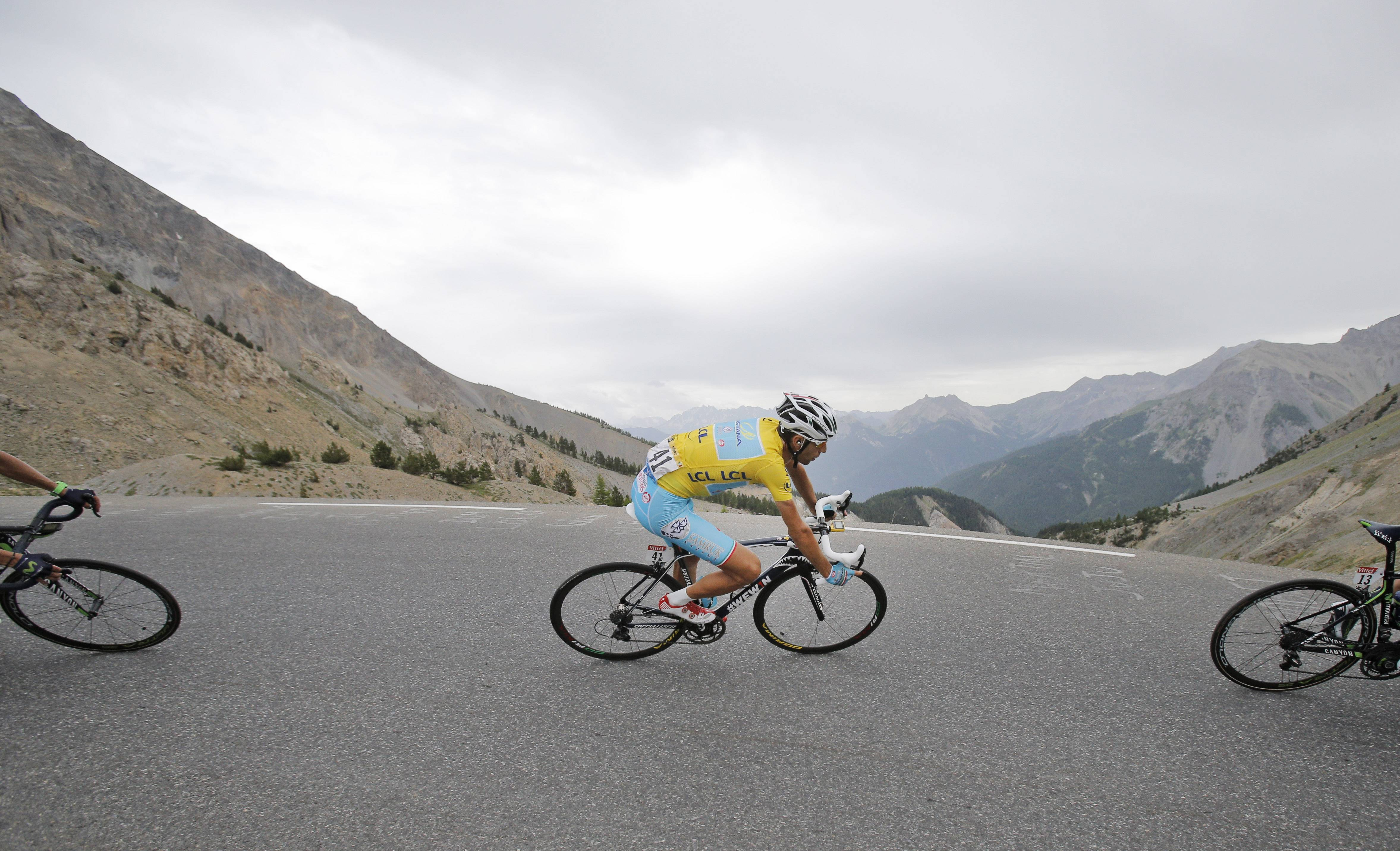 Italy's Vincenzo Nibali, wearing the overall leader's yellow jersey, speeds down Izoard pass during the 14th stage of the Tour de France on Saturday.