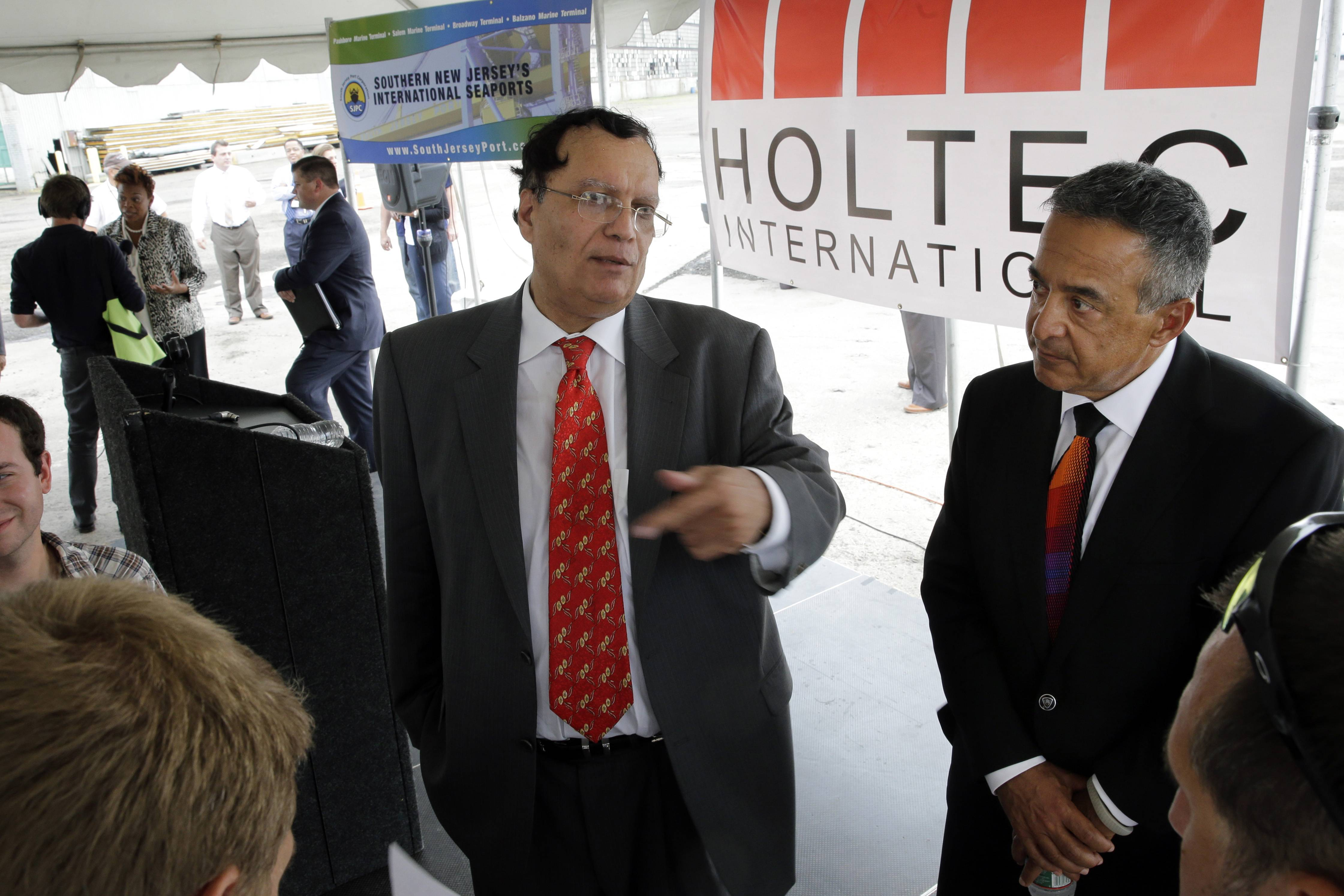 Kris Singh, center, the founder, president and CEO of Holtec International answers a question Monday in Camden, N.J. The company that makes components for power plants said it eventually expects to bring 3,000 jobs to the facility it plans to build in Camden, one of the nation's poorest cities. New Jersey raised its mandatory minimum wage this year.