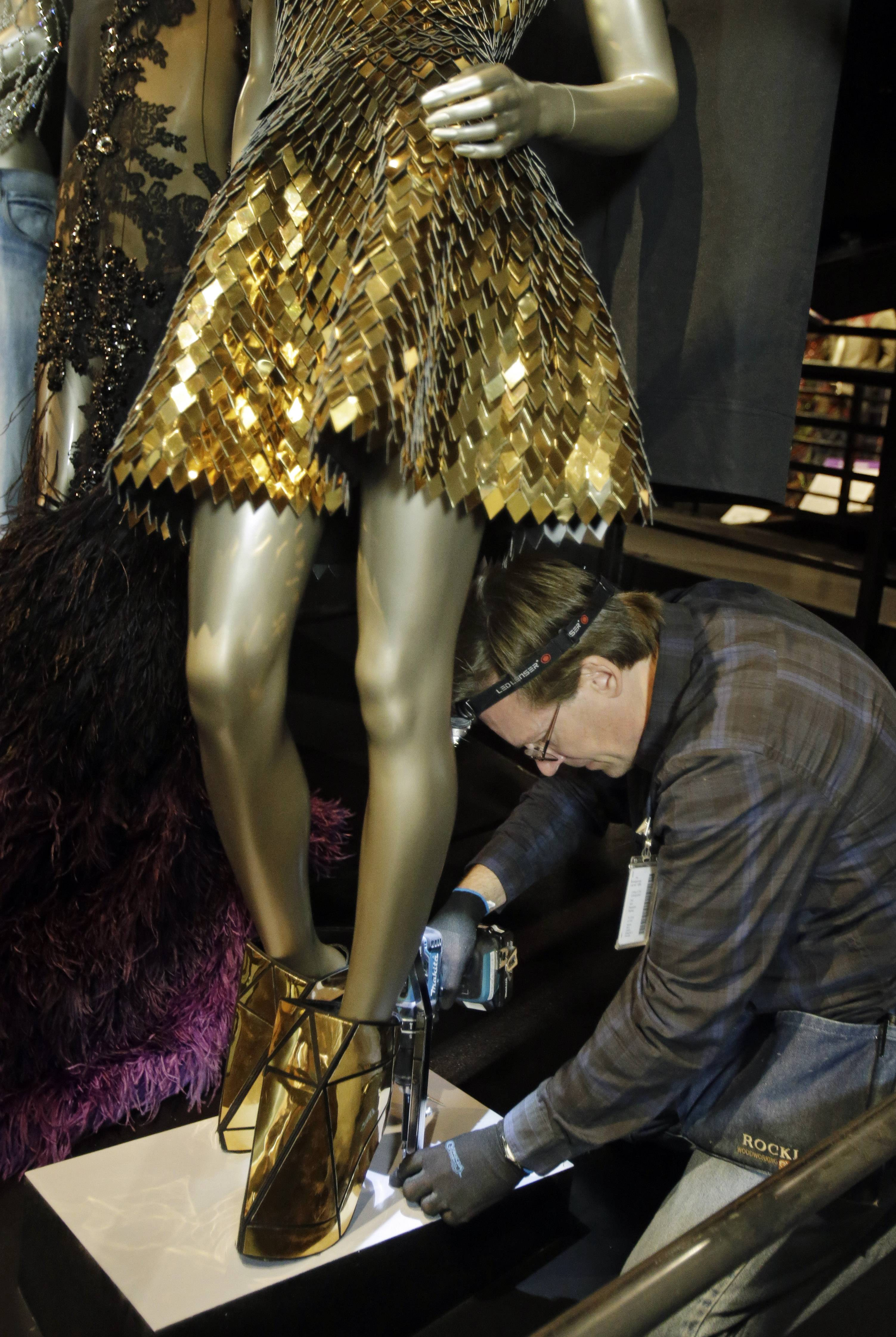 "Andre Sepetavec secures a mannequin with the outfit from Beyonce's ""Run the World (Girls)."""