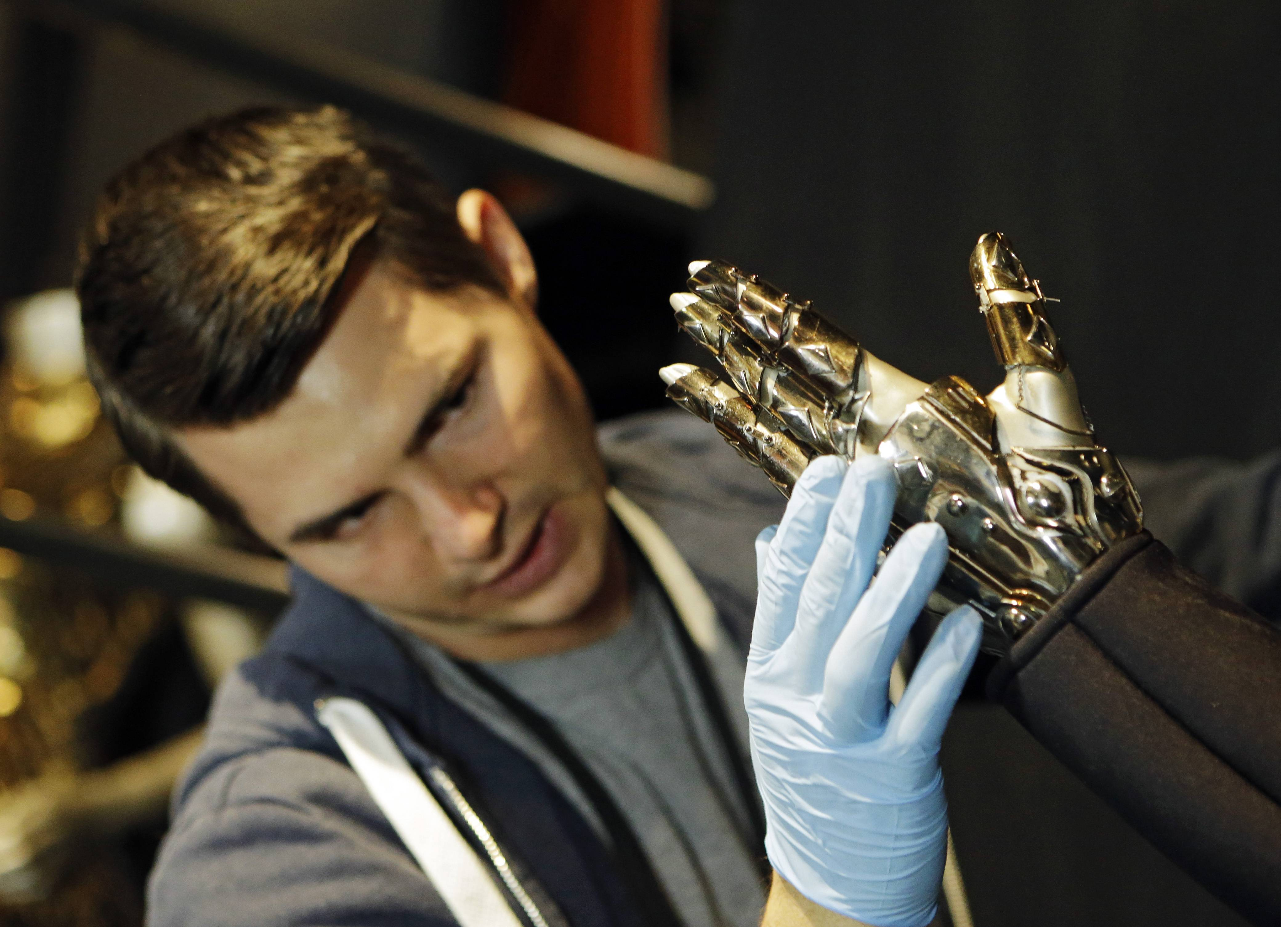 "Matt Seaman adjusts the glove from Beyoncé's ""Single Ladies"" outfit during installation at the Rock and Roll Hall of Fame in Cleveland."