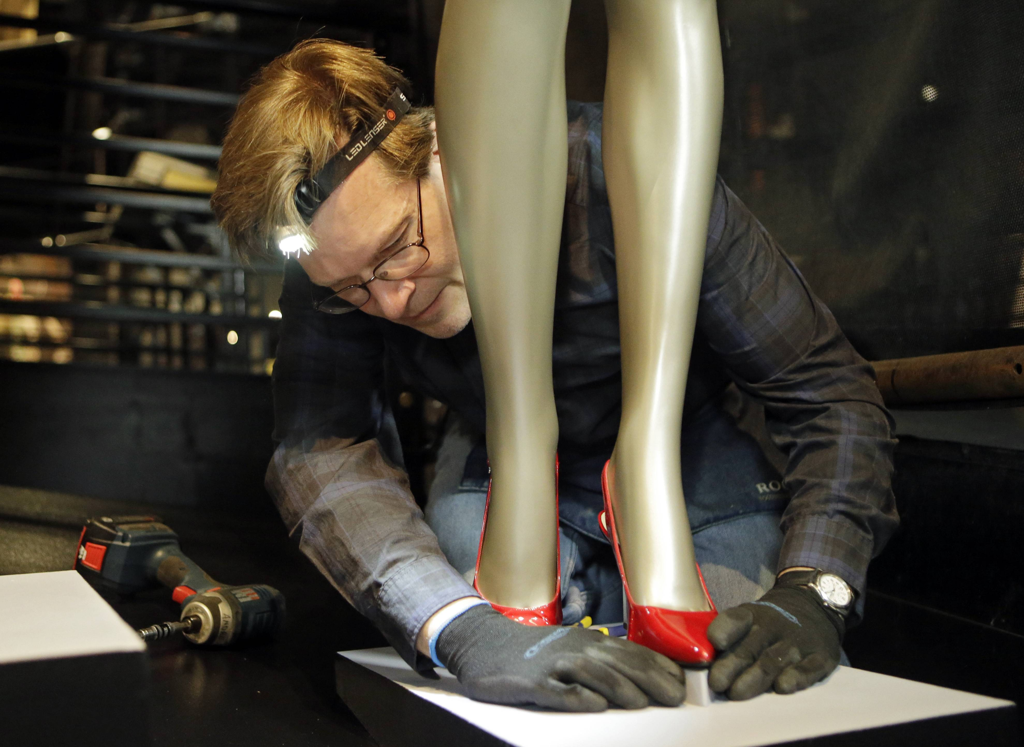"Andre Sepetavec adjusts the shoes for Beyonce's ""Crazy in Love"" outfit during installation of the new exhibit at the Rock and Roll Hall of Fame in Cleveland."