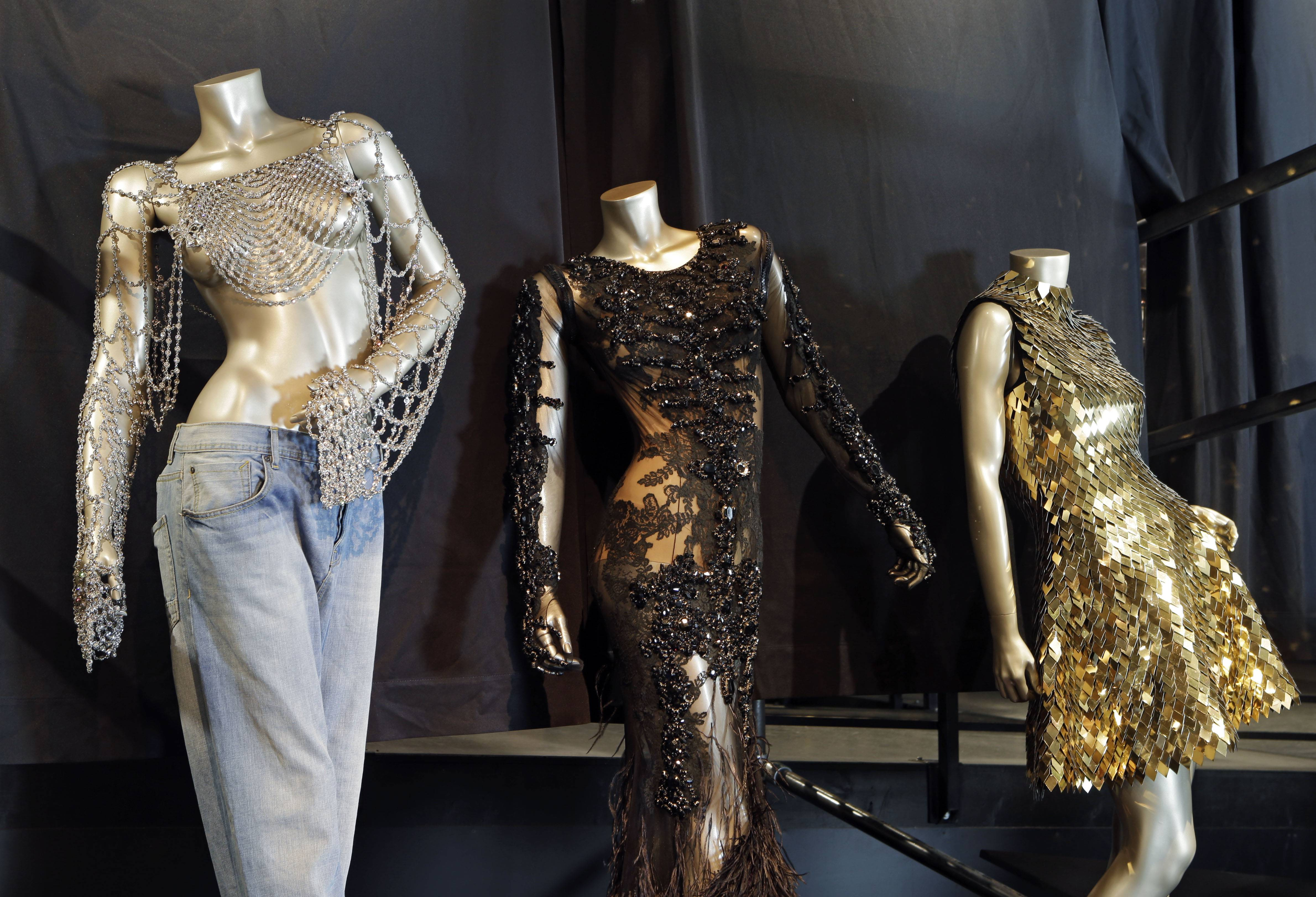 "From left, outfits from Beyonce's 2003 ""Dangerously in Love,"" 2012 ""Met Gala"" and 2011 ""Run the World (Girls)"" are shown in a new exhibit at the Rock and Roll Hall of Fame in Cleveland."