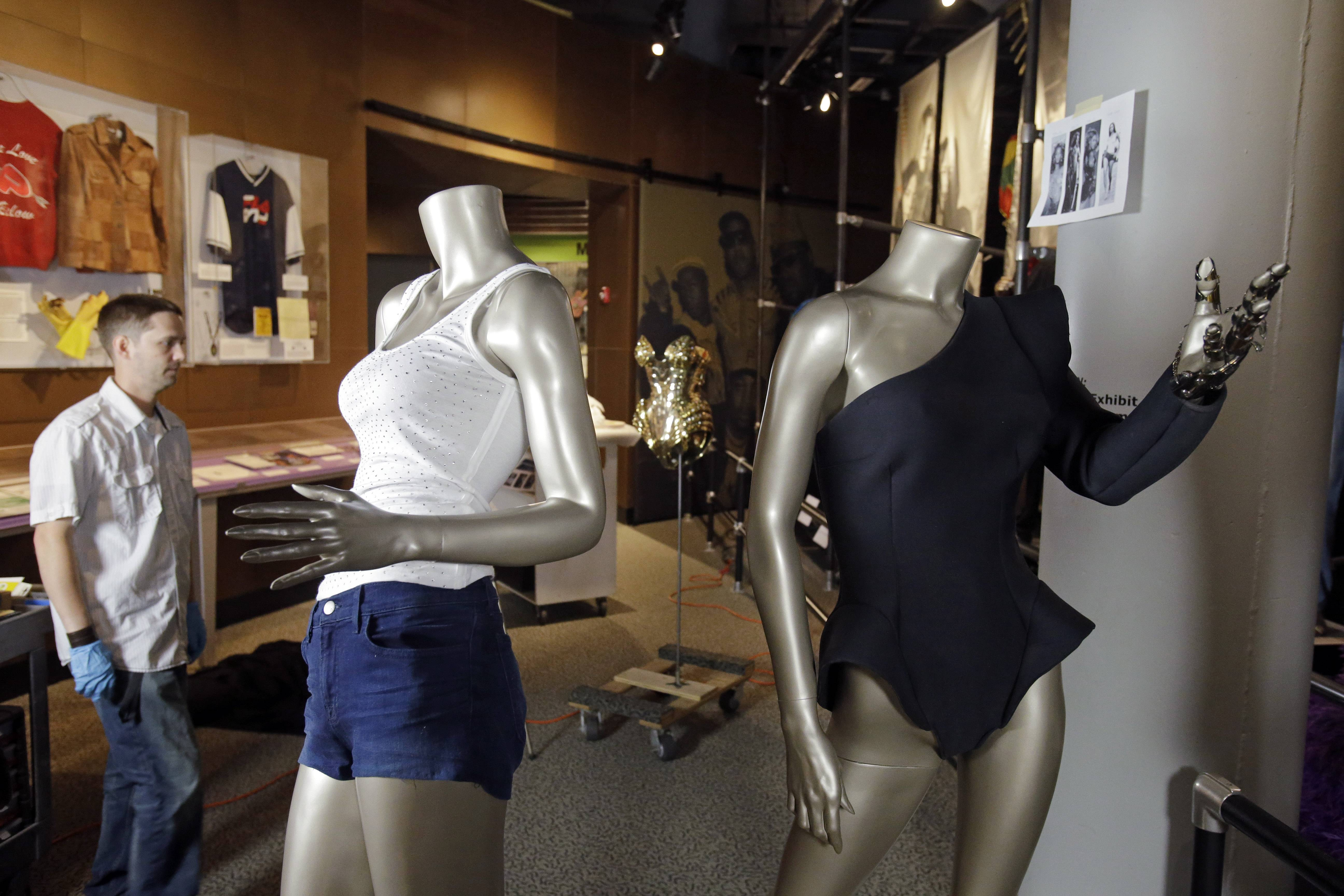 Exhibit designer John Sloboda, left, watches as the Beyoncé exhibit is installed at the Rock and Roll Hall of Fame in Cleveland.