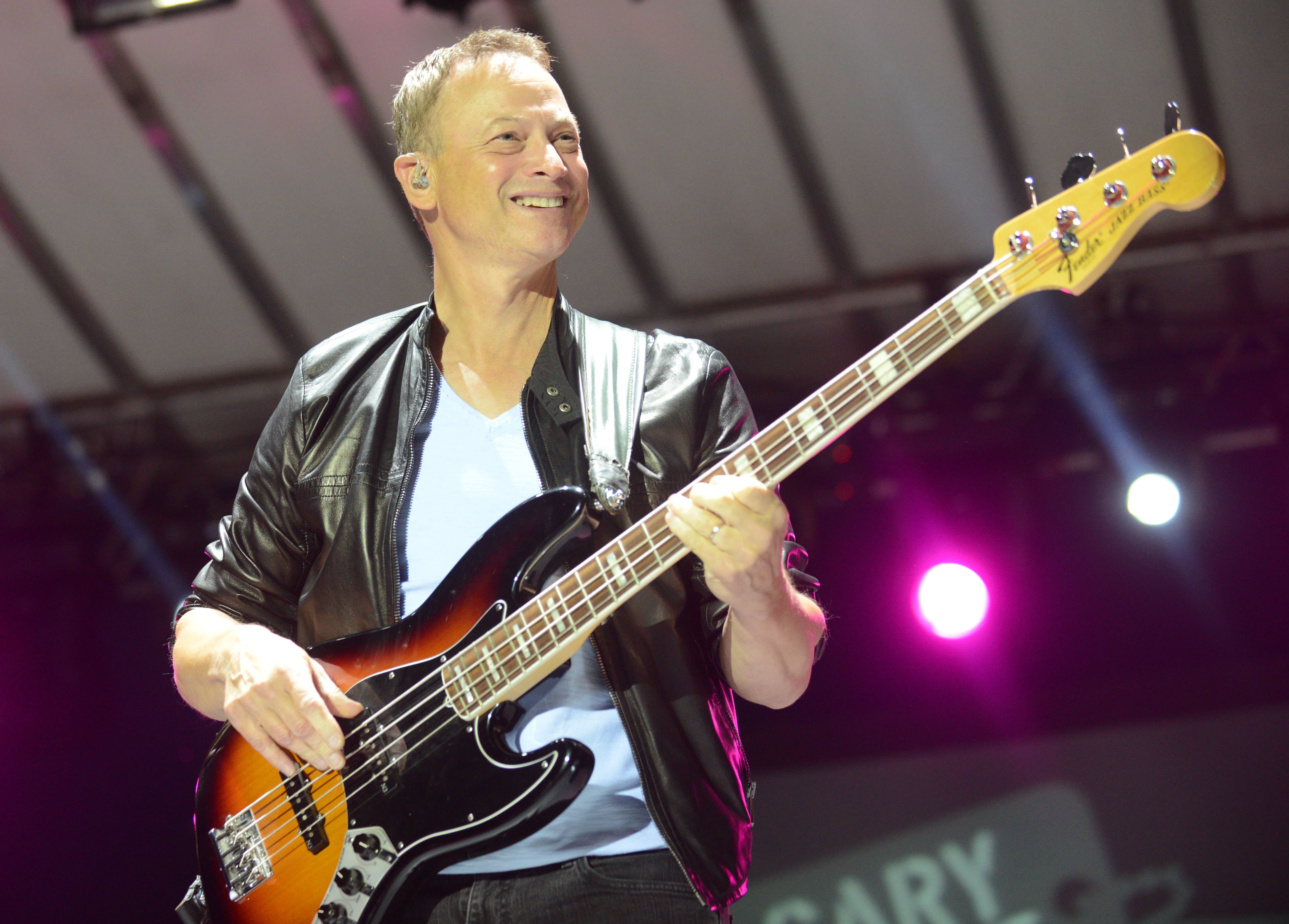 Actor Gary Sinise and his Lt. Dan Band, took the stage around 8: 45 p.m. Saturday in Wheaton's Cantigny Park. The concert raised money for Operation Support Our Troops America, an organization formed by a couple of Naperville moms to provide care packages for our troops overseas.