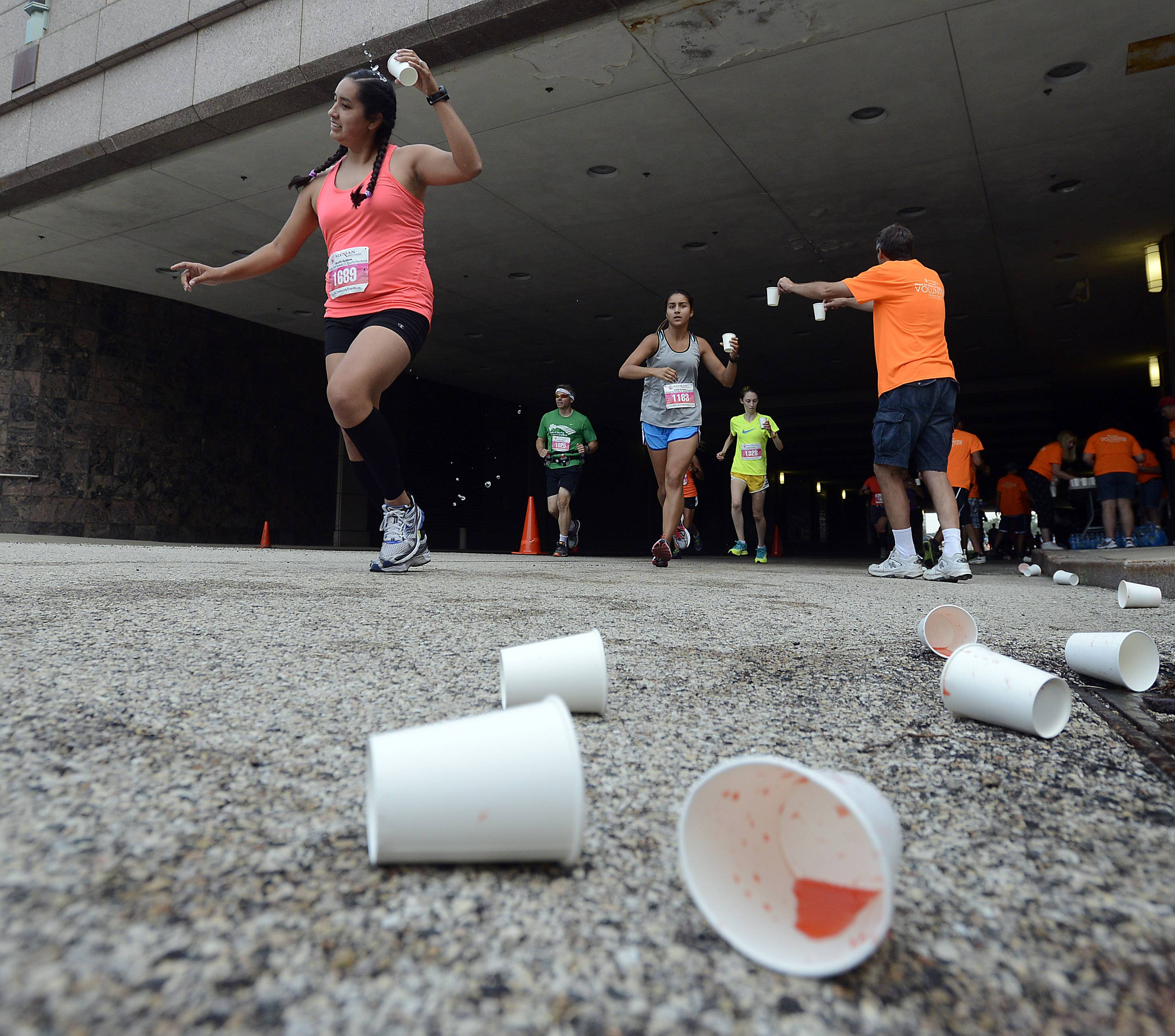 Runners in the half marathon gets some refreshment from the water station Saturday in the sixth annual Alexian Brothers Fitness for America Sports Festival in Hoffman Estates.