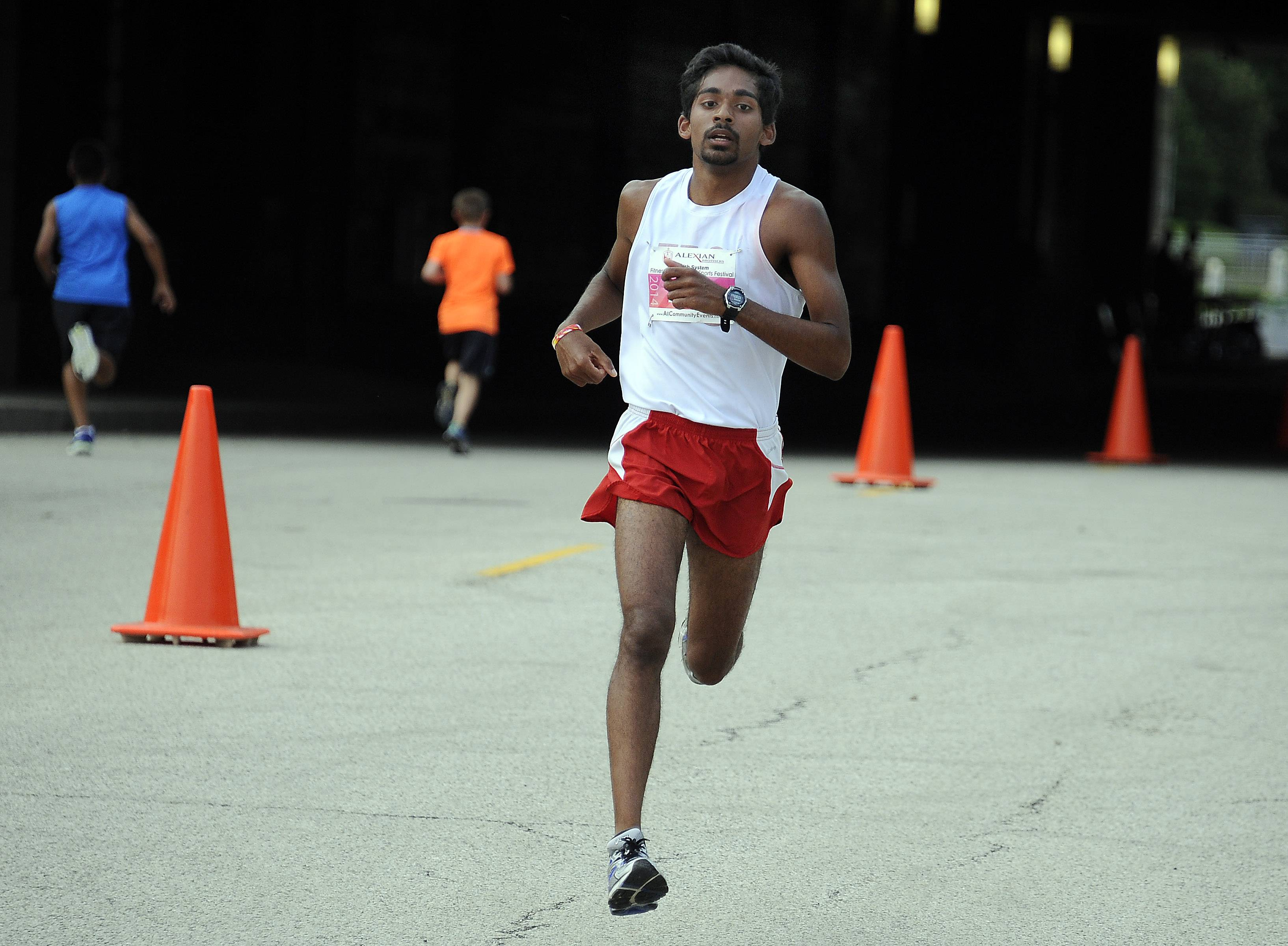 Andrew Philipose of Mount Prospect finishes first in the 10K race at the sixth annual Alexian Brothers Fitness for America Sports Festival half marathon race Saturday in Hoffman Estates.