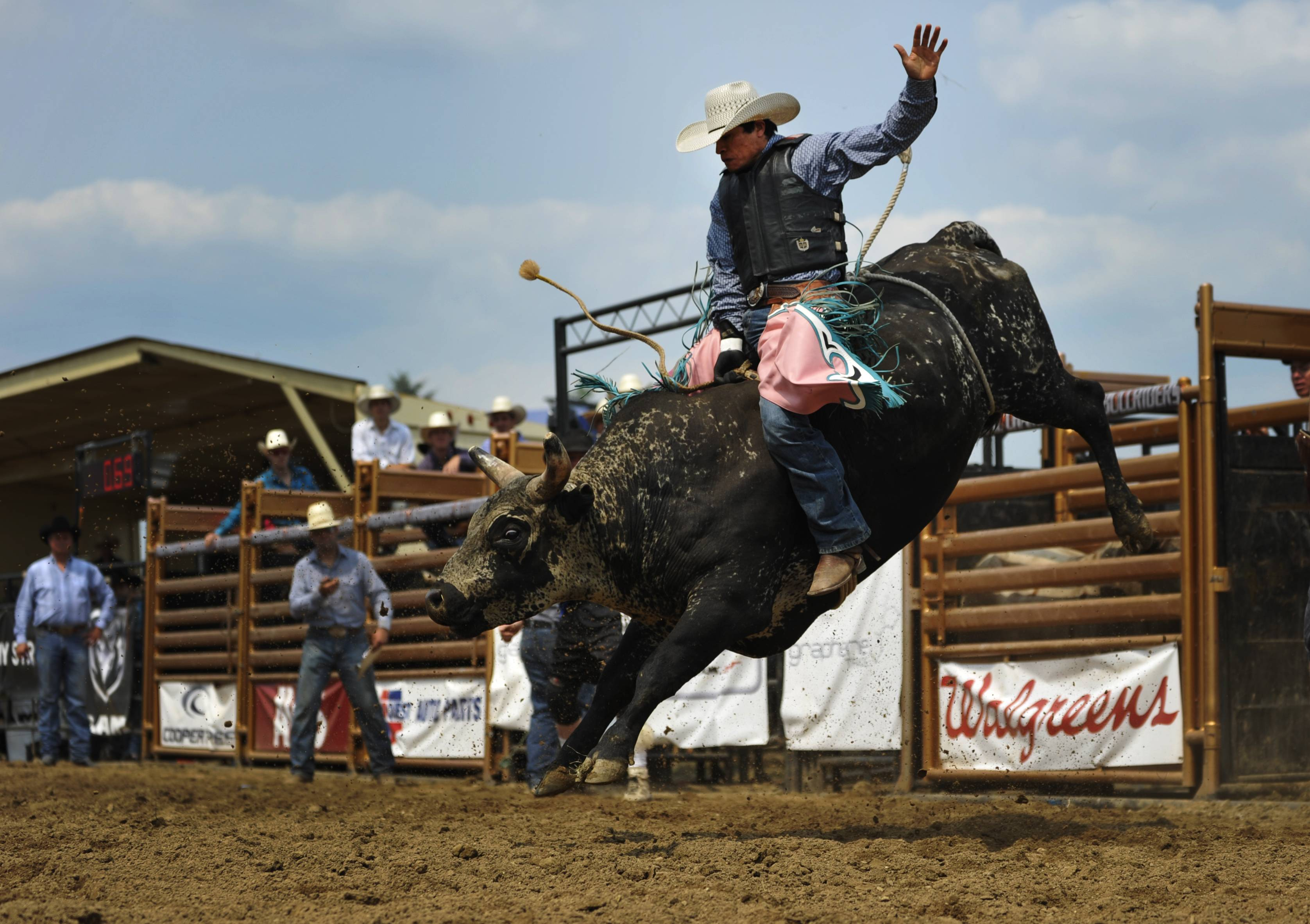 Sergio Gonzales of Guatemala manages to stay on the bull at the Kane County Fair Saturday afternoon. The third round in the competition was Saturday night.