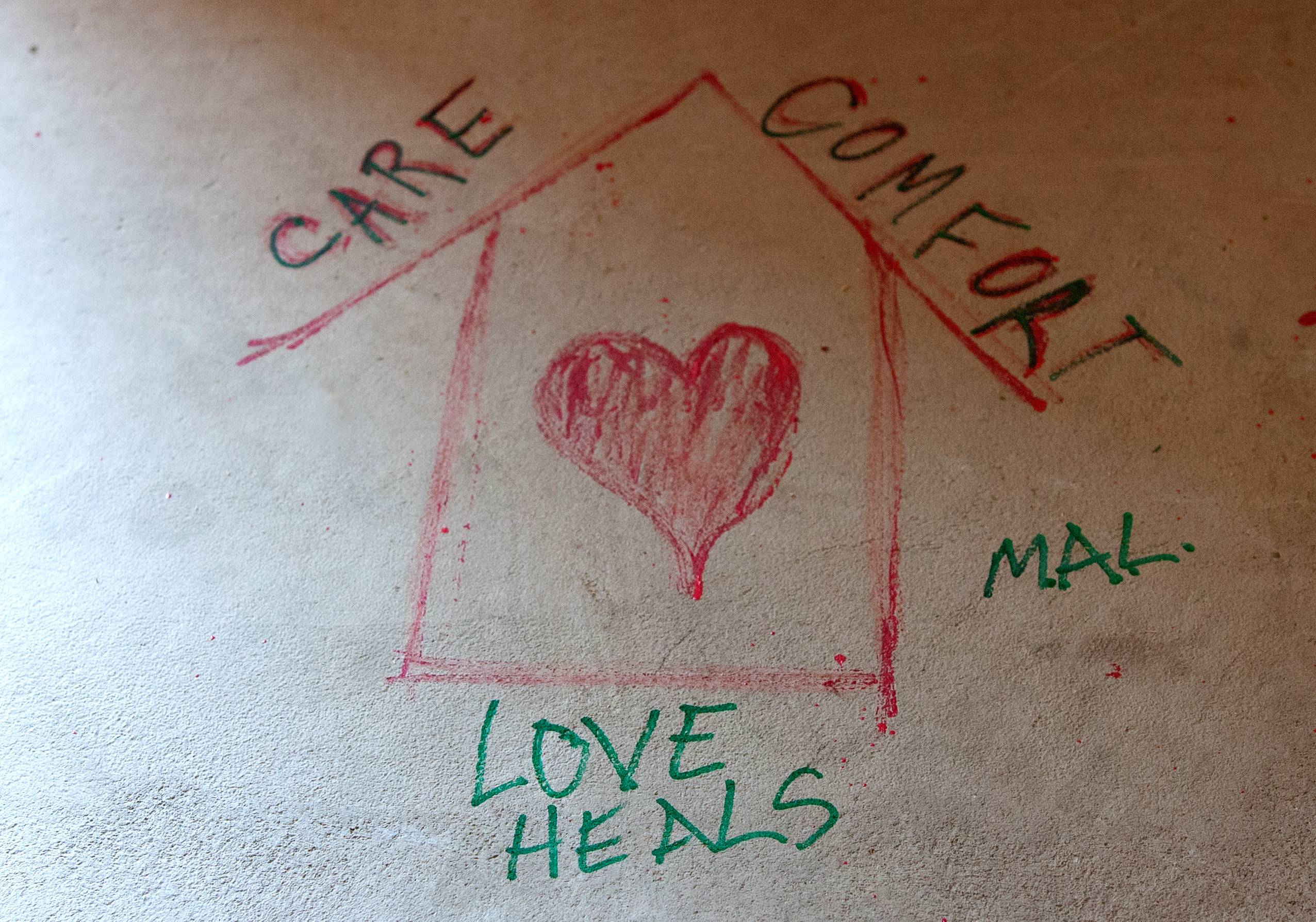 Caring thoughts are written on the foundation living room floor during a tour of the Ronald McDonald House across from Central DuPage Hospital in Winfield.