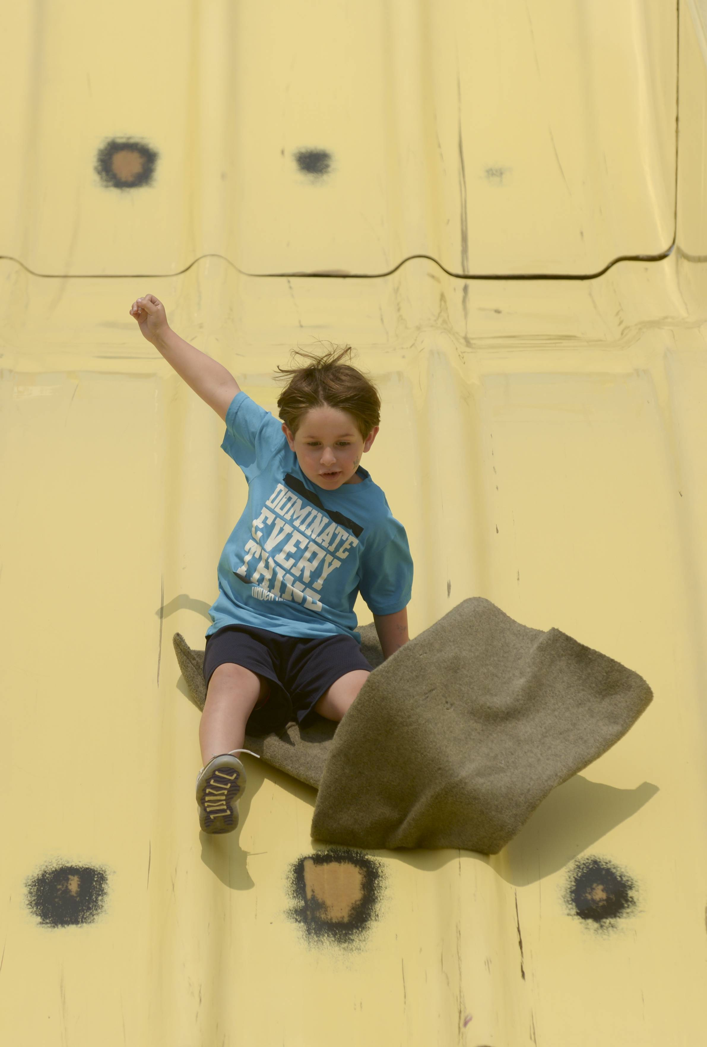 Jeremy Zamost, 6, of Libertyville zooms down the Fun Slide on Saturday at the Vernon Hills Summer Celebration.