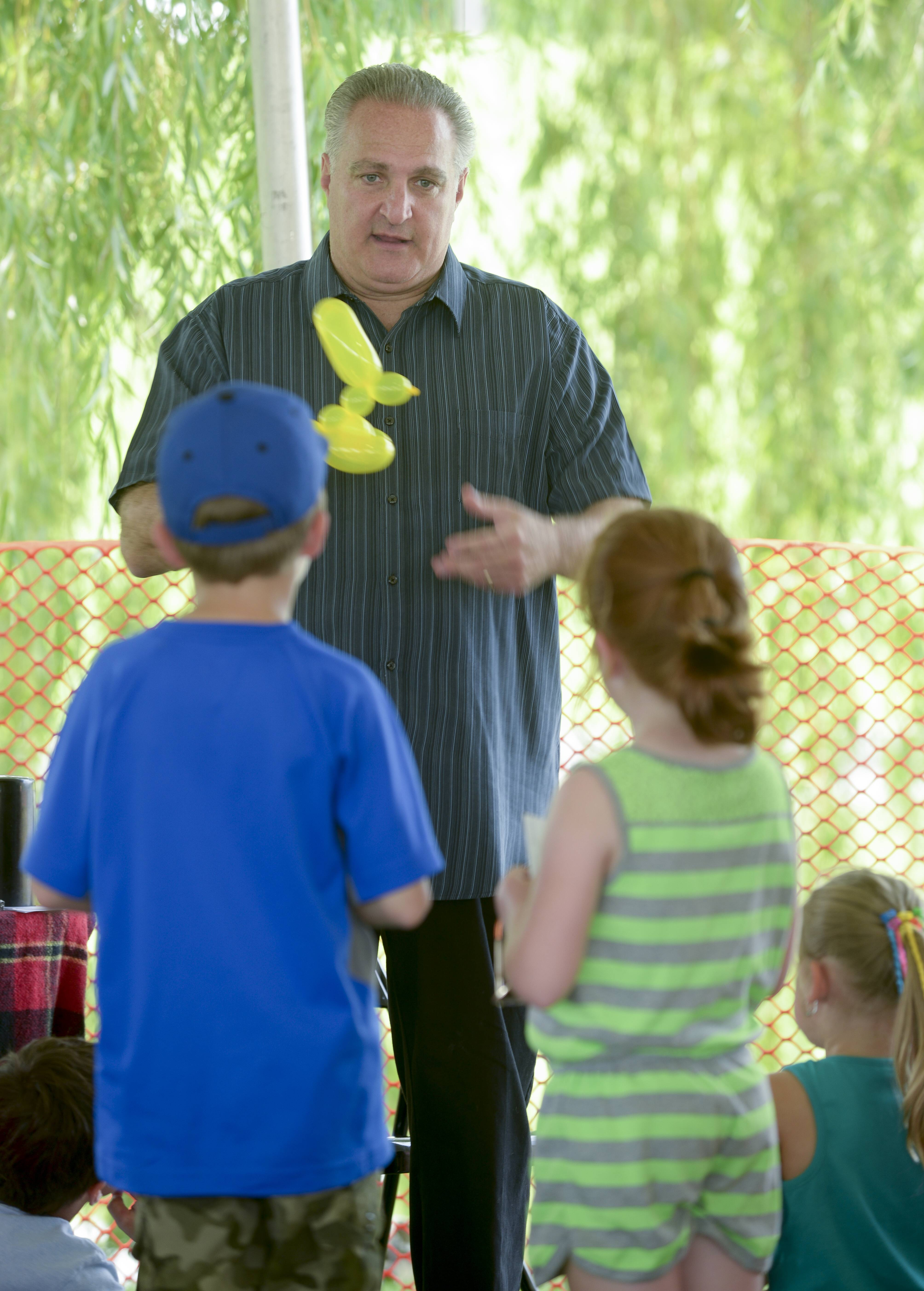 Al Brodosky makes some ballon animals during his free magic show for children Saturday at the Vernon Hills Summer Celebration. Brodsky is a longtime Vernon Hills resident and professional magician and children's entertainer.