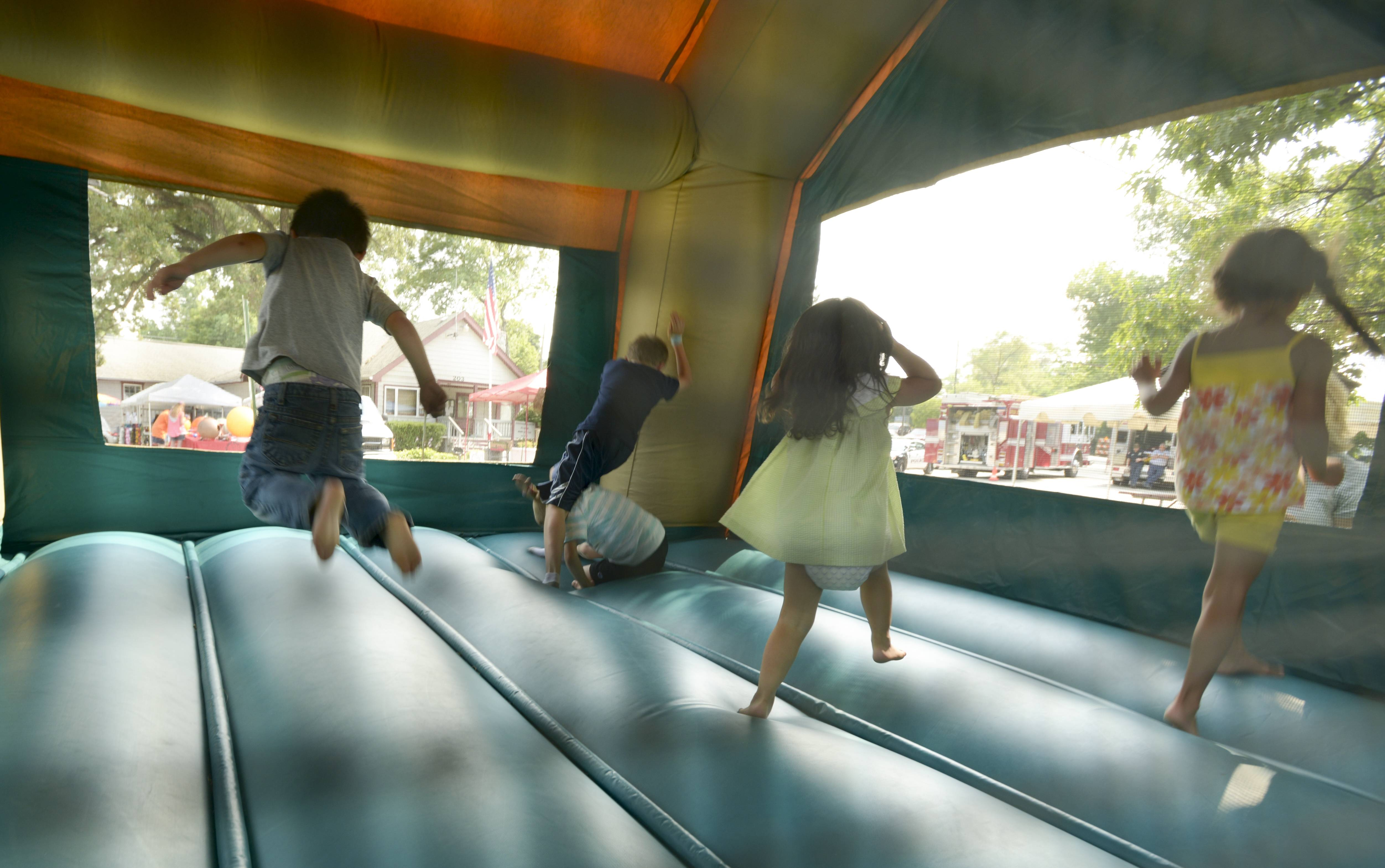 Kids play in the jump house Saturday at Round Lake Park's annual Lake Front Summer Festival.