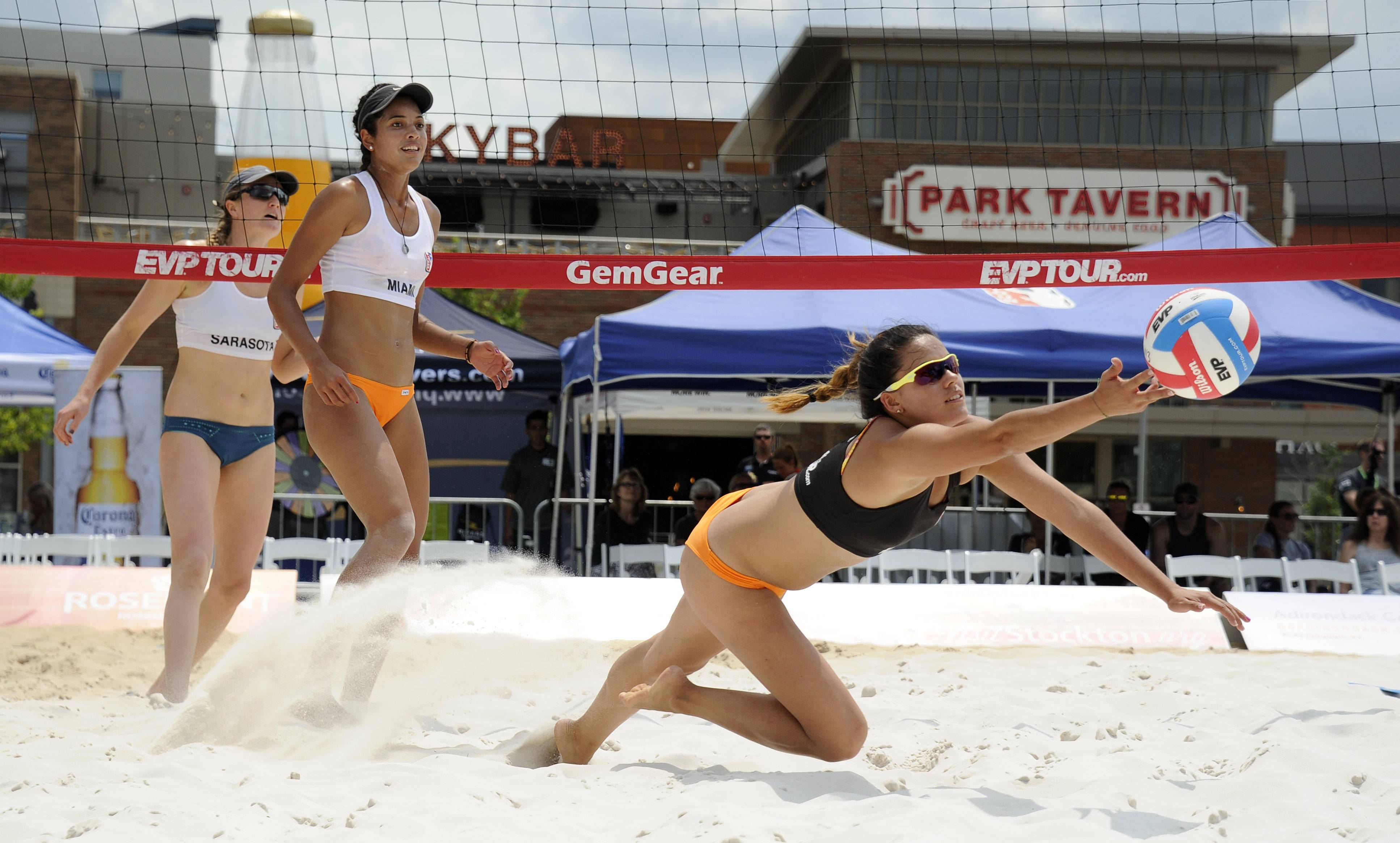 Margarita Guzman of Colombia dives for the ball during the EVP Rocks Rosemont professional beach volleyball tournament.