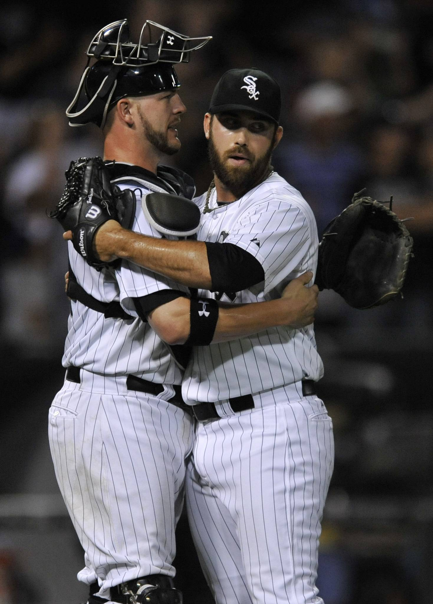 White Sox reliever Zach Putnam, right, celebrates with catcher Tyler Flowers after picking up the save in Saturday night's 4-3 victory over the Astros at U.S. Cellular Field. Flowers drove in the go-ahead run in the fifth inning with a double.