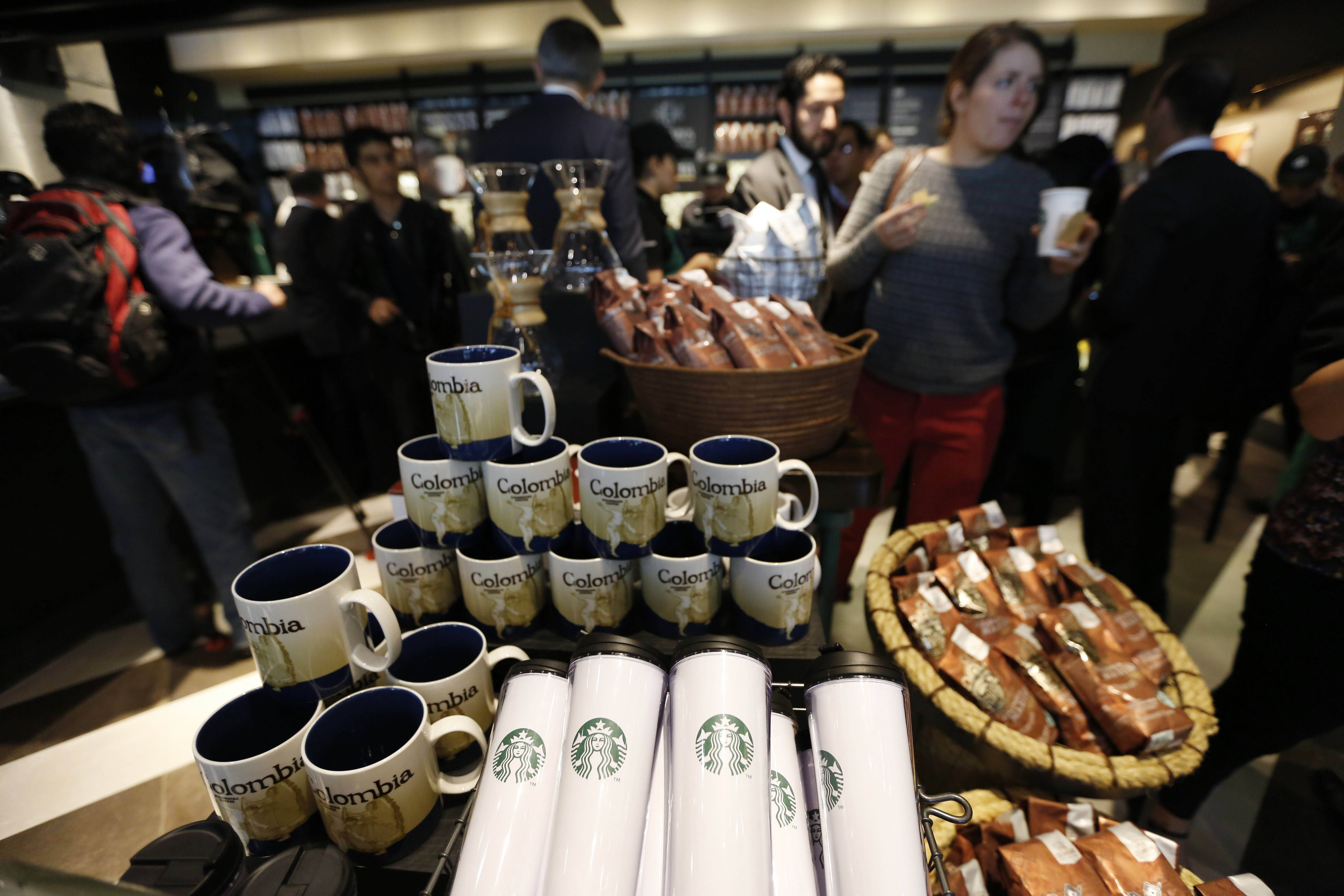 Journalists tour the first Starbucks the day before its public opening in Bogota, Colombia, Wednesday, July 16, 2014. The three-floor coffee house in Bogota is the first of 50 that the Seattle-based company plans to open here in the next five years.
